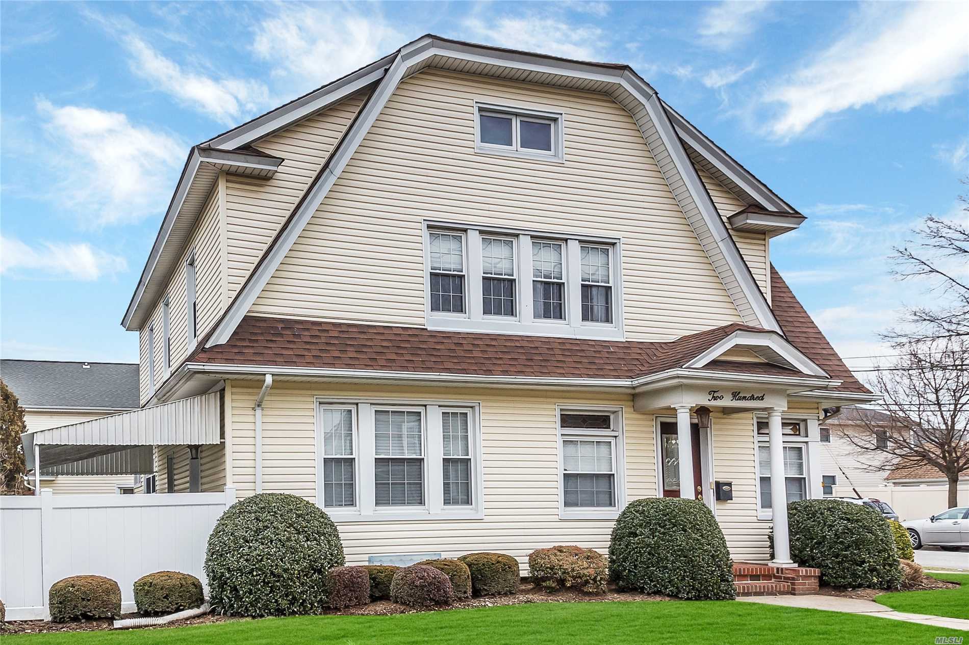 Beautifully Updated 4 Bedroom Dutch Colonial In The Park Section Of Mineola. Featuring-Large Foyer, Living Room W/Fireplace, Formal Dining Room W/ Wall Molding & Coffered Ceilings, 2 Full Baths, Eat-In-Kitchen W Granite Counters & Ss Appliances, Full Finished Basement & Attic, All Hardwood Floors-Even The Attic! Covered Porch, Large Driveway W/2 Car Garage, Close To Lirr, Library, Park, Hospital & Close To Shopping & Restaurants . Seeing Is Believing! A True Must See..