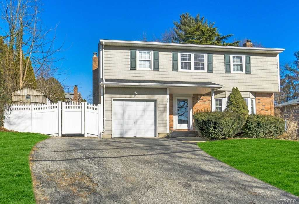 Start Packing! Bright Colonial With Eat In Kitchen, Living Room, Dining Room, Den With Fireplace. Master Bedroom With Full Bath, 3 Additional Bedrooms. Hardwoods Throughout, Stone Retaining Walls, Pavers All Around Yard. 1 Car Garage With Extra Driveway!