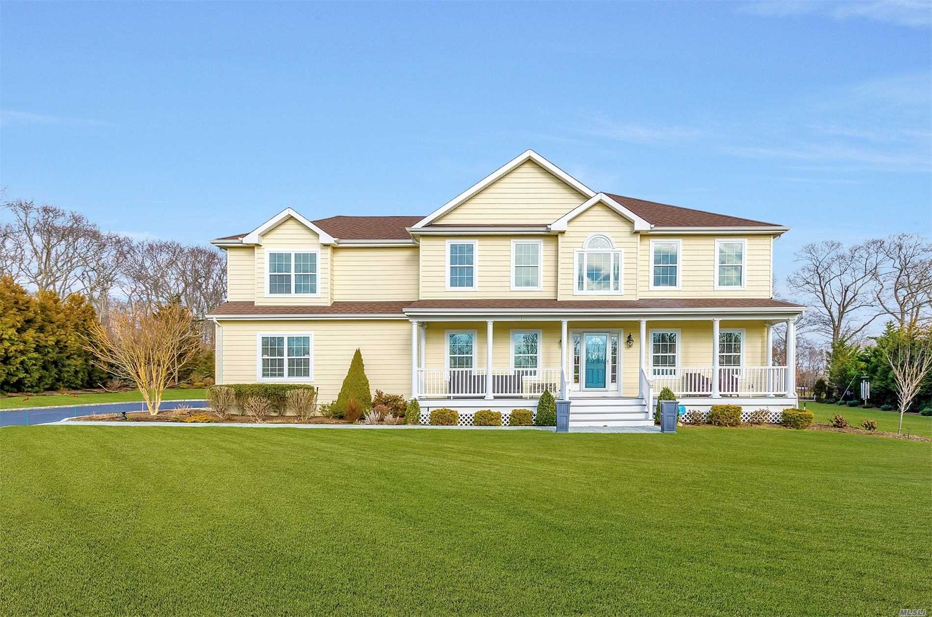 The Pleasures Of Long Island's North Fork Right At Your Doorstep. This Pristine 2012 Built 5 Bedroom Colonial Sits On A Secluded 3 Home Private Dead End Cul De Sac. Expansive Vista-View Back Yard With Specimen Plantings And Lots Of Room To Play. Wonderful Year Round Community Interspersed With Second Homes For Urban Dwellers Seeking A Country Oasis. Quality Built Home With 9 Foot Ceilings, Fireplace, Central Air, Custom Cherry/Granite Kitchen And Moldings, Garage And Basement. Come See It Soon!!