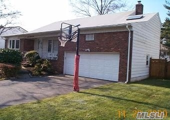 Spacious and Airy Split On Oversized Property Features 5 Bedrooms, 3 Updated Baths, Cac, Formal Dining Room, Hardwood Floors, Skylights, Den with Fireplace plus Finished Basement, Large Master Bedroom with dressing area,  Alarm, 2 Car Garage, Large Fenced in Yard,  Quiet Street, French Drain, Sandy Dry!