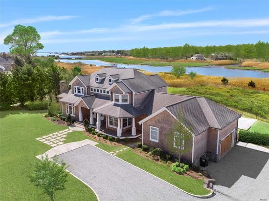 Immerse yourself in the sights & sounds of nature on 1.8 creek front acres. Meticulously rebuilt, 5 bdrm home offers light-filled foyer, cathedral GR, DR, den, office, chef's kitchen/breakfast nook. Three separate sleep areas for privacy for all; first floor master suite., second floor junior master plus 2 Bdrms/bath/loft. Additional, private guest suite. Outside, lush, private grounds, gunnite wf pool/spa, small dock and SUNSETS! Perfect sanctuary.
