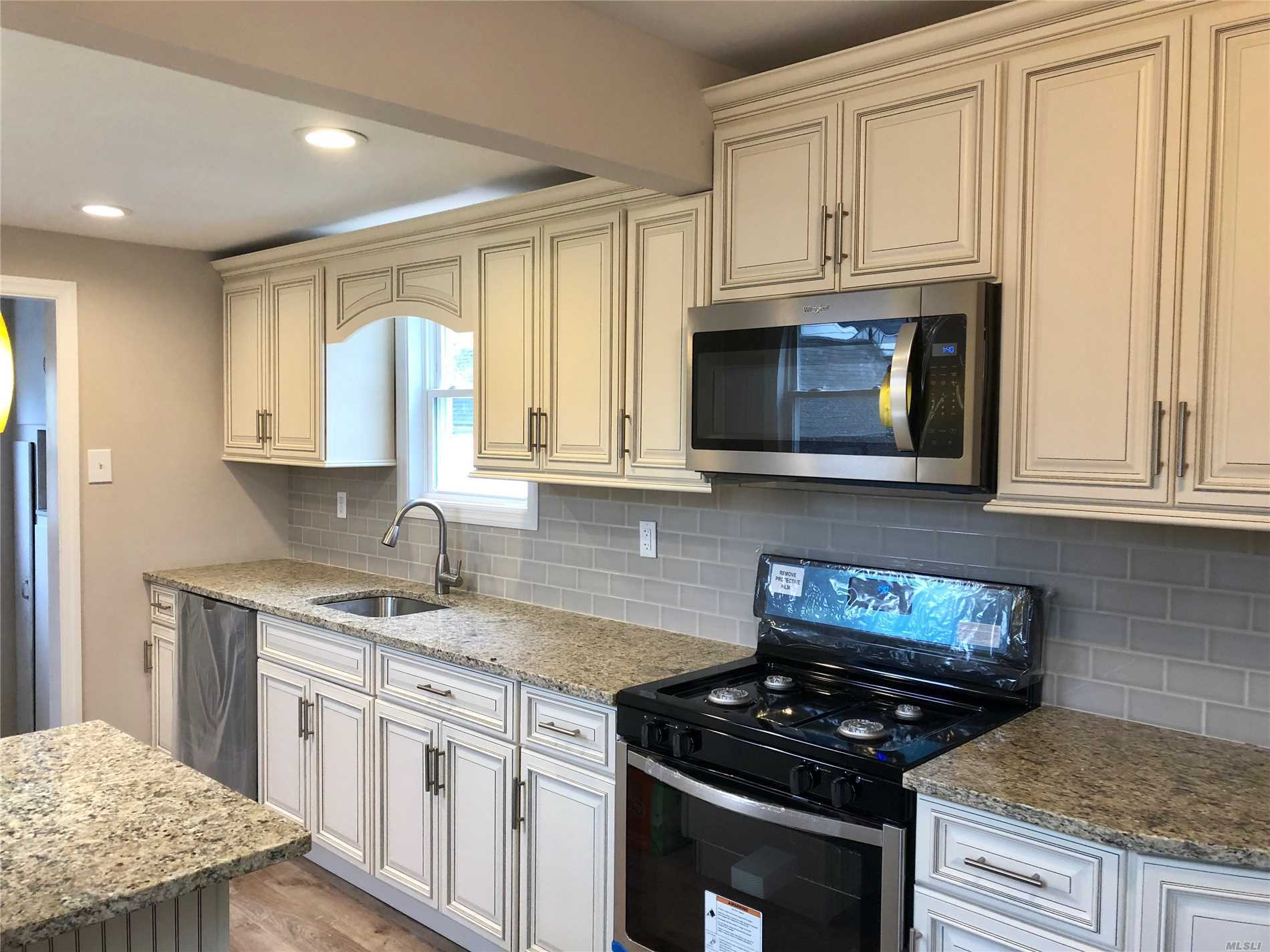 Charming Redone Cape In Sd#17 With Great Proximity To All. Features New Kitchen W/Granite And Stainless Steel Appliances.New Bath And Hardwood Floors. Updated Roof W/New Windows And Gutters. This One Wont Last!