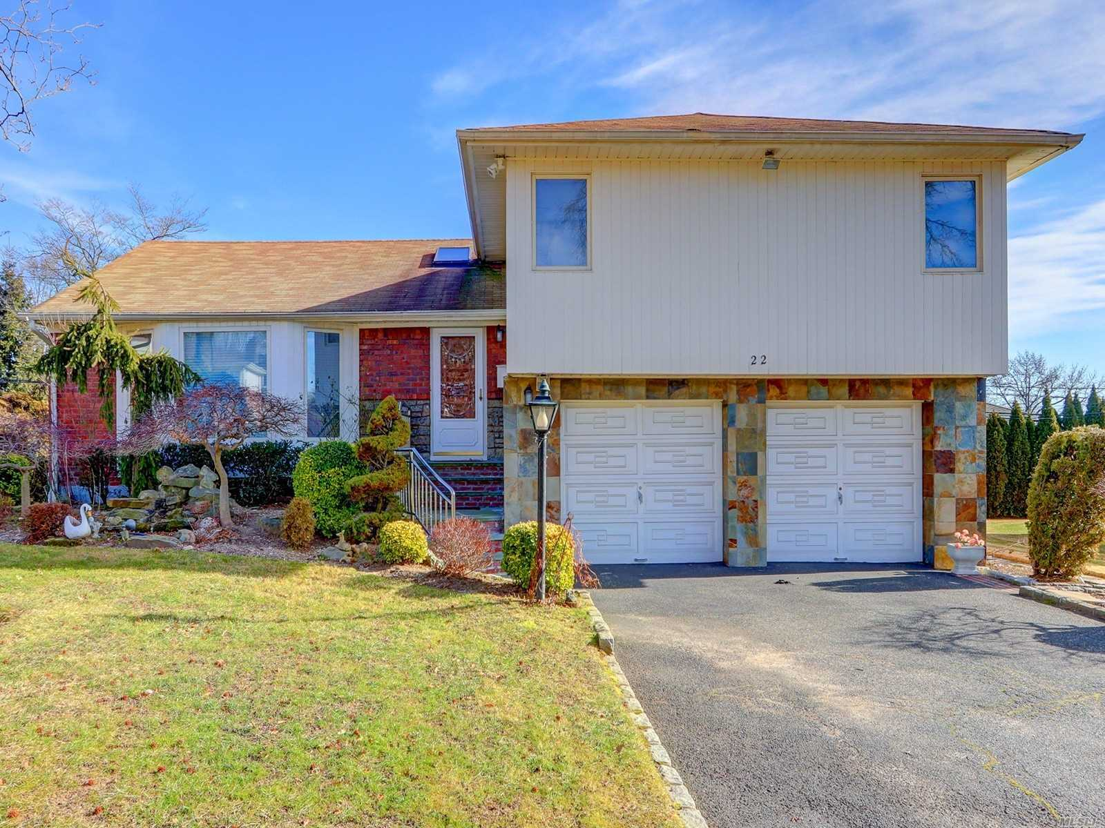 This Is The Home You Have Been Waiting For! Move In Ready, 2235 Sq. Ft., Split In The Heart Of Manhasset Hills/Desired Herricks Sd! Huge Living Room & Dining Room, Family Room Extension Off Large Eik W/Granite Counters. First Fl Has A Nice Size Den W/Fp And .5 Bath, Finished Bsmt & Lg Bdrs. Bright Home W/6 Skylights, Recently Sand/Polished Wood Floors, New Den Carpet, Newly Painted, Boiler Fairly New, Beautifully Landscaped Grounds W/Fountain, Ig Sprinklers & 2 Car Gg. Taxes Grieved!