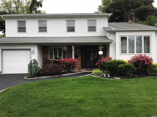 Customized Colonial Like No Other. Designer Kitchen With High End Appliances, Wood Floors Throughout, Large Landscaped Yard With Canopied Patio And Hot Tub-Perfect For Entertaining