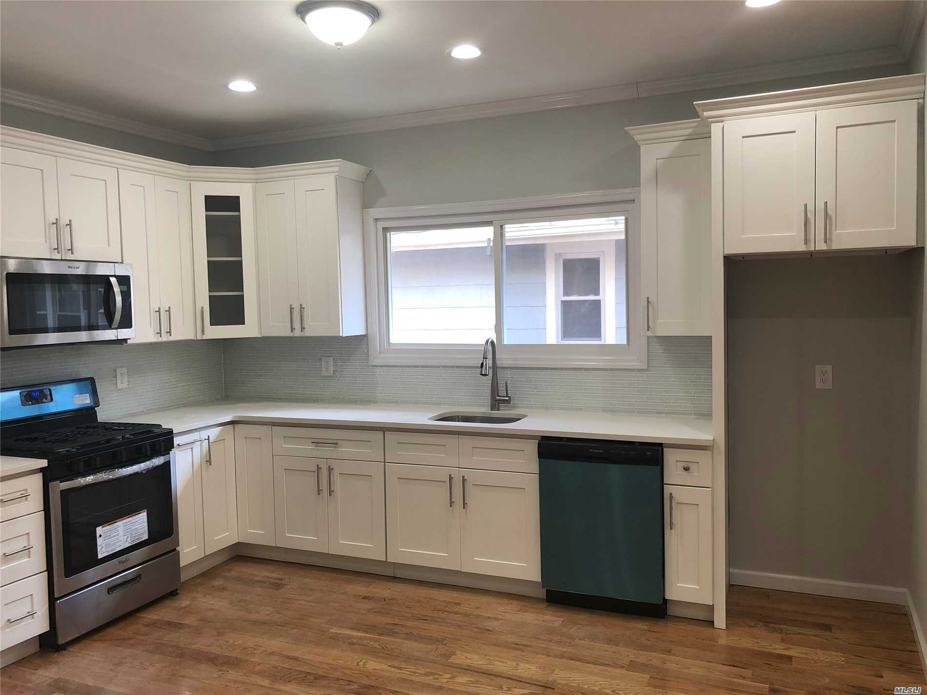 Fully Renovated Brick Home With Four Bedrooms & Four Full Bathrooms. Master Bedroom Has En-Suite Master Bath W/ Jacuzzi Tub. Large Modern Eat In Kitchen, High Ceilings, Huge Basement With Bath And Hookups, Tons Of Possibilities. Driveway And Garage, New Roof! Great Location, Convenient To Everything, Wont Last!