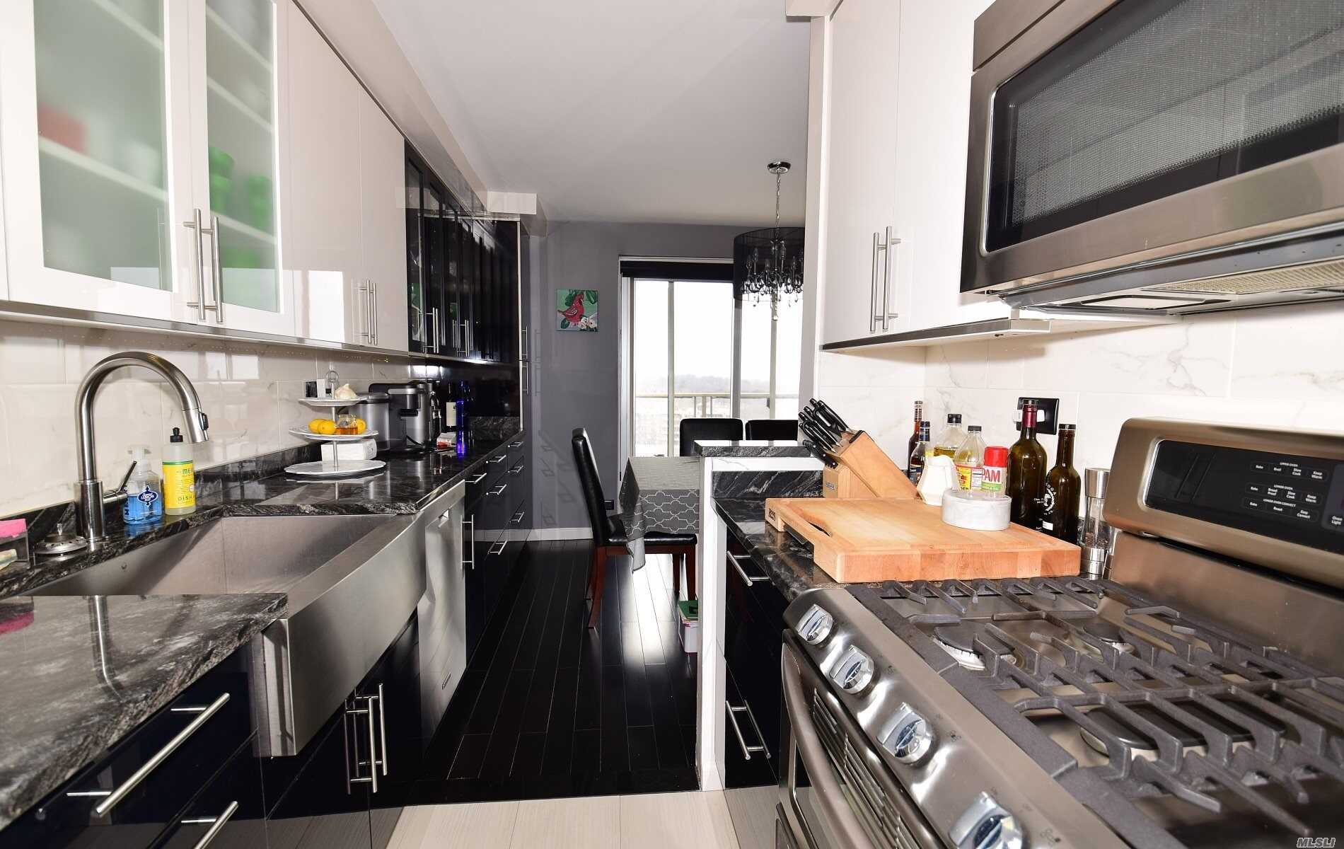 Resort-Style Living, Corner Deluxe One Bedroom Jr-4, 16th Floor, Dining Room, Upscale Extended Kitchen With Commerical Stainless Steel Appliances, Top Of The Line Wood Cabinets, Granite Counter Tops, Bamboo Hardwood Floor, Mable Bathroom, . Largest Tiled Terrace With Unobstructed Views Of Manhattan Skyline, Bridges & Water, Dog Friendly, Reserved Indoor Parking, Gym, Pool, Tennis, Stores, 30 Mins From City By Lirr Or Express Bus, 24Hr Notice Needed.