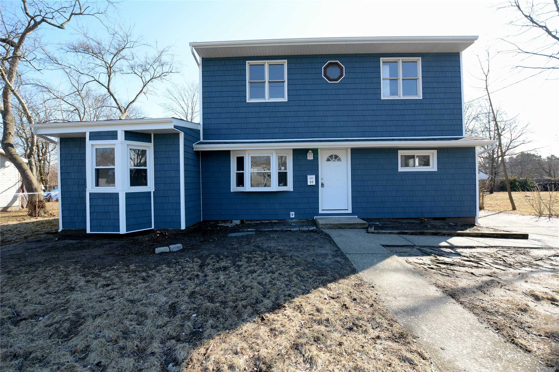 Move In Ready! Attention To Detail, Situated On A Quiet Residential Block. Large Spacious Home In Immaculate Condition, New Roof, New Siding, New Cesspools, New 200 Amp Service, New Ss Kit, 2 New Baths, New Wood Floors. Ceramic Tile In Entry Way Kit And Mud Room.
