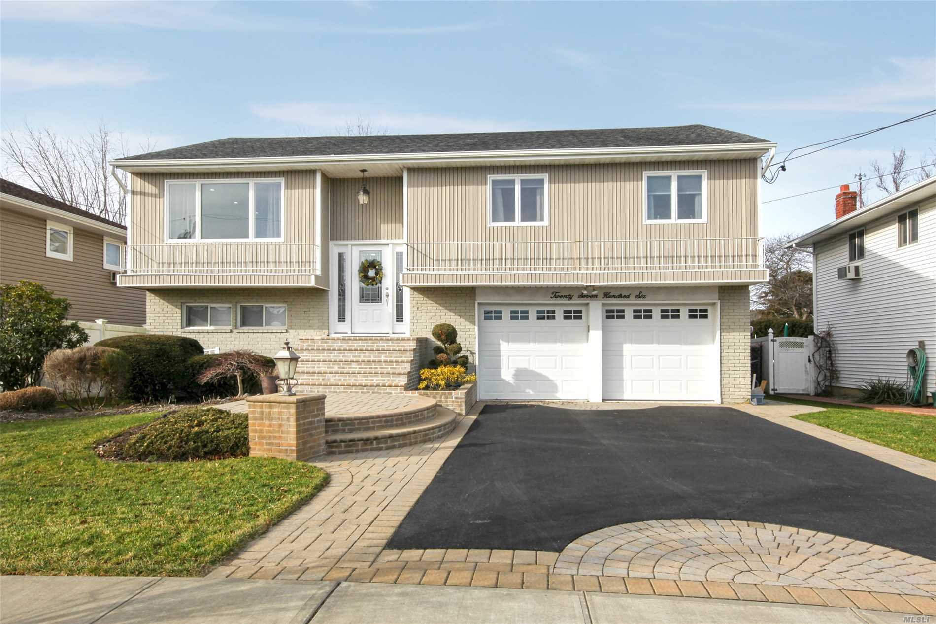 This Is A Wow! Waterfront Beauty! Better Than New! 2 Yr Old Quartz/White Wd And Ss Eik W/ Center Isle, Farm Sink, Sbway Bk Splash, Soft Slide Drawers & Pullouts. Open Layout, Led Hi Hats, Gleaming Wood Floors, 20 X 40 Expansion, With Huge Den W/ Vaulted Ceiling. Newer Lg W/D On Main Level, Master Suite W/ New Marble Bathrm, Large Wic, 3 Additional Large Bedrms, Lower Level Perfect M/D W/ Summer Kitchen, Large Bdrm, Den W/ Fp, Newer2 Car Garage, Powder Rm W/ Access From Country Club Yard Huge Room