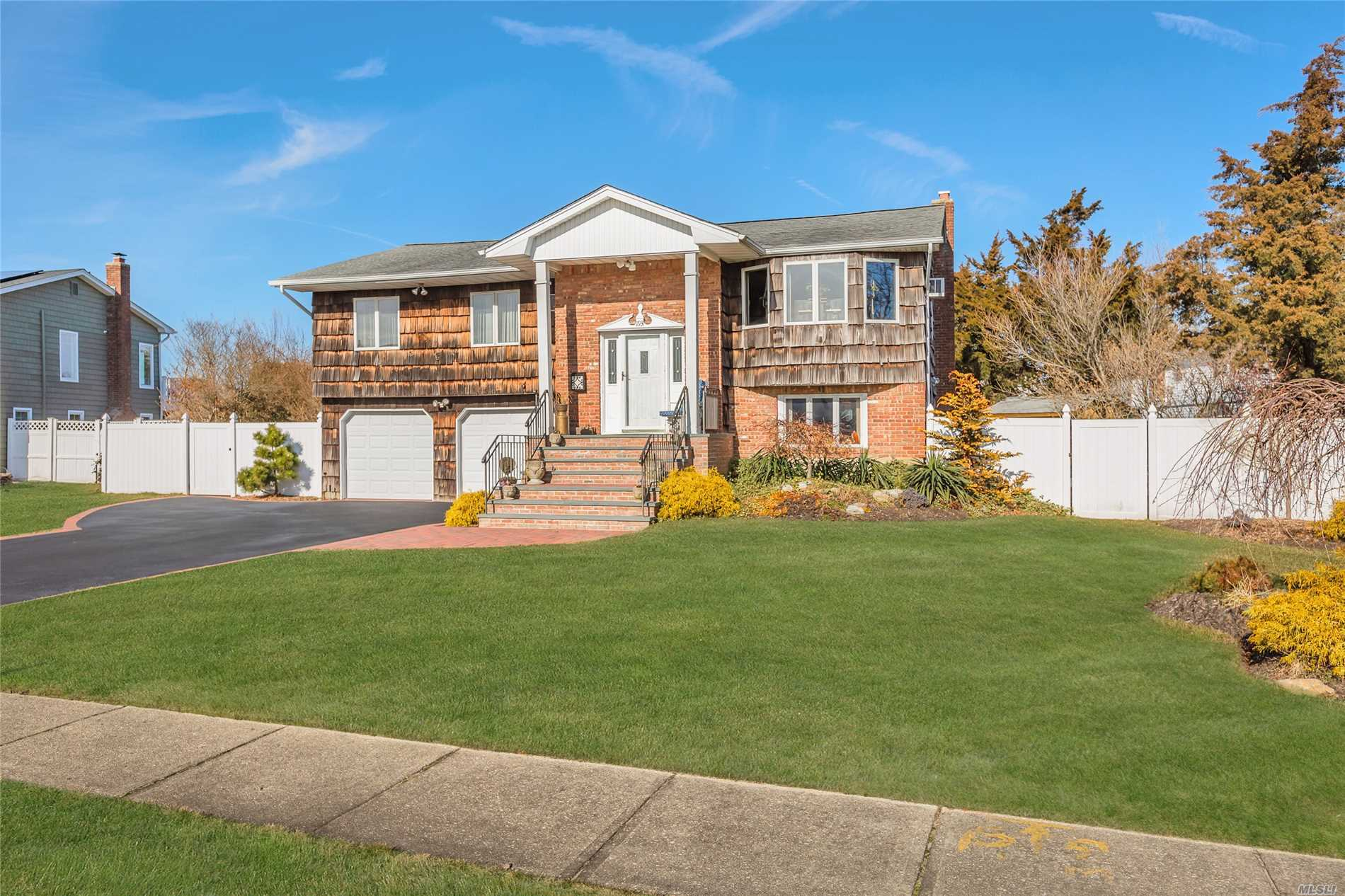 Captree Landings Waterfront Home South Of Montauk Highway On A Cul-De-Sac. This Home Is Wonderful For Entertaining Offering A Heated Igp 18X36, 2 Wooden Decks, Patio Pavers,  35' Navy Bulkheading 2013, New Pavers And Stoop, Eik W/ S/S Appliances & Granite Counters & Much More! Basic Star $1, 164.37. Attic With Pull Down Stairs.