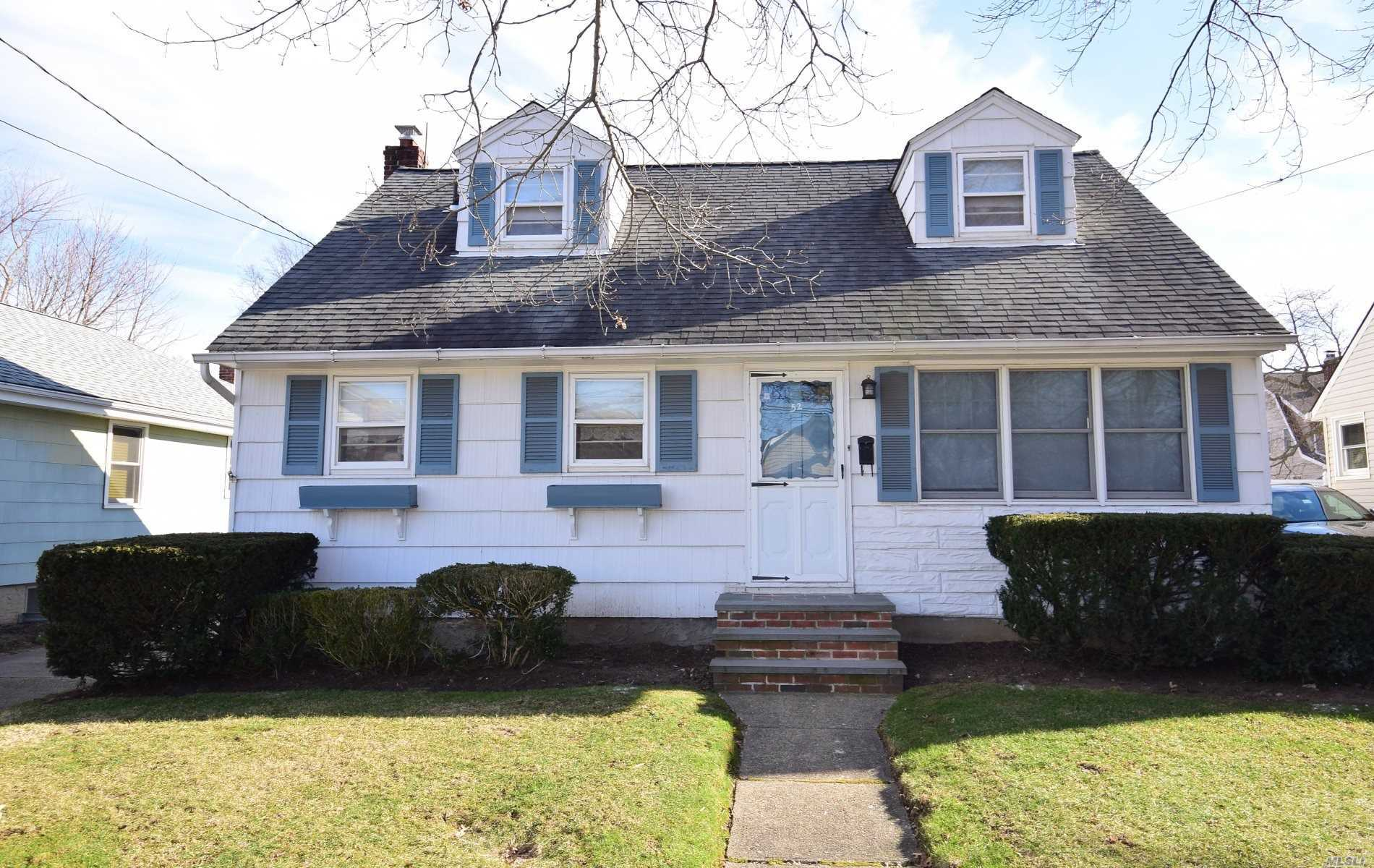 Spacious Cape, Home Features 4 Brs, 2 Full Bths, Living Rm, Oversized Eik, Dining Rm/Den, Full Basement With High Ceilings, 2 Car Garage. Located On Residential Block, Short Distance To Rail Road, Shops, Greiss Park. Tax Grievance Has Been Filed + Seller To Offer $3, 000 Towards 2019 Taxes.