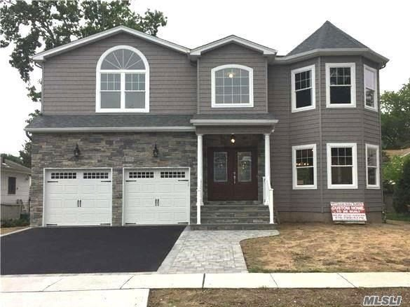 *Photos Shown Are Of Exact Model Home Built Previously By Same Quality Builder. Approx 3, 100 Total Int Sf Designed To Perfection & To-Be-Built W/ Utmost Quality Of Craftsmanship By Bldr Of 30+ Yrs/400+ Homes. Large 4 Bdrm, 2.5 Bath Gorgeous Colonial W/ 2-Car Gar, Front Paver Walkway To Bluestone Stoop/Porch, Eat-In-Kitchen W/Top-Of-Line S.S. Appliances & Full Unfinished Bsmt. Pristine Bellmore Loc & Close To Lirr/Dining/Shops/Etc. No Amenities Spared. Top Notch Energy-Efficient New Construction!