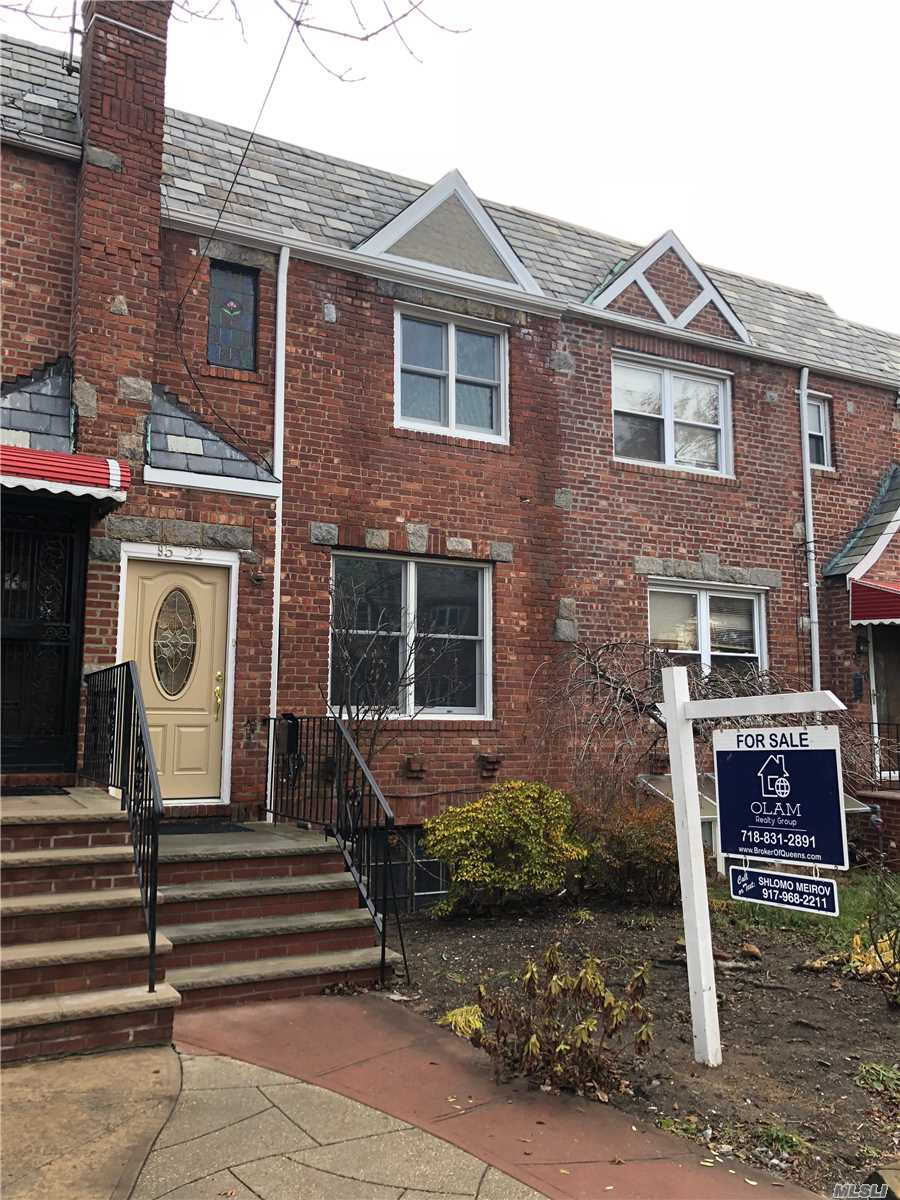 Brick Tudor Townhouse In Rego Park Bordering Forest Hills, Spacious Living Room, Formal Dining Room With Open Kitchen, Powder Room And Open Porch, 2 Large Bedrooms And A Full Bath On The Second Floor. Basement With A Mil Apartment, And Access To Back Parking.