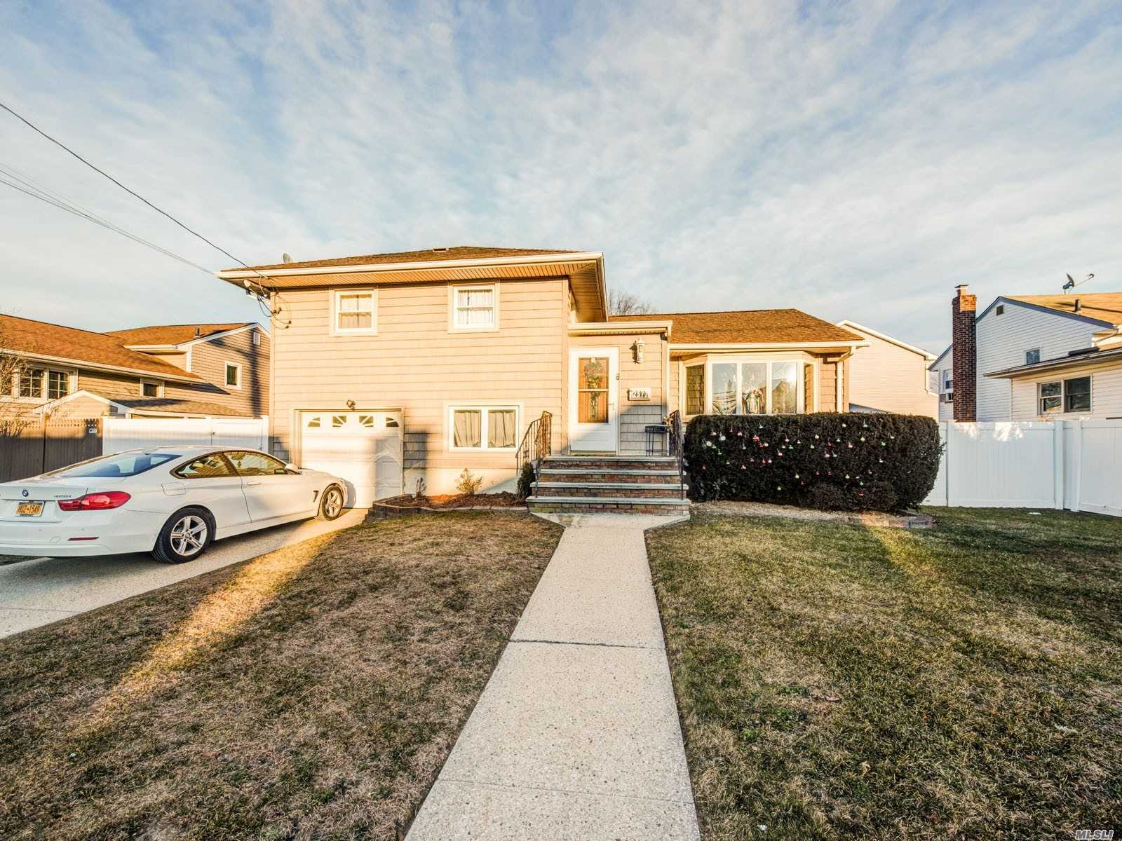 Renovated 4 Bedroom, 2 Full Bath Split Level Single Home Features Custom Granite Kitchen, Updated Baths, New Heating System, New Central Air Conditioning, New Siding, New Windows, New P.V.C. Fencing. The House Is Located At Great Area - Just 30 Minutes To Brooklyn, 40 Minutes To Manhattan.