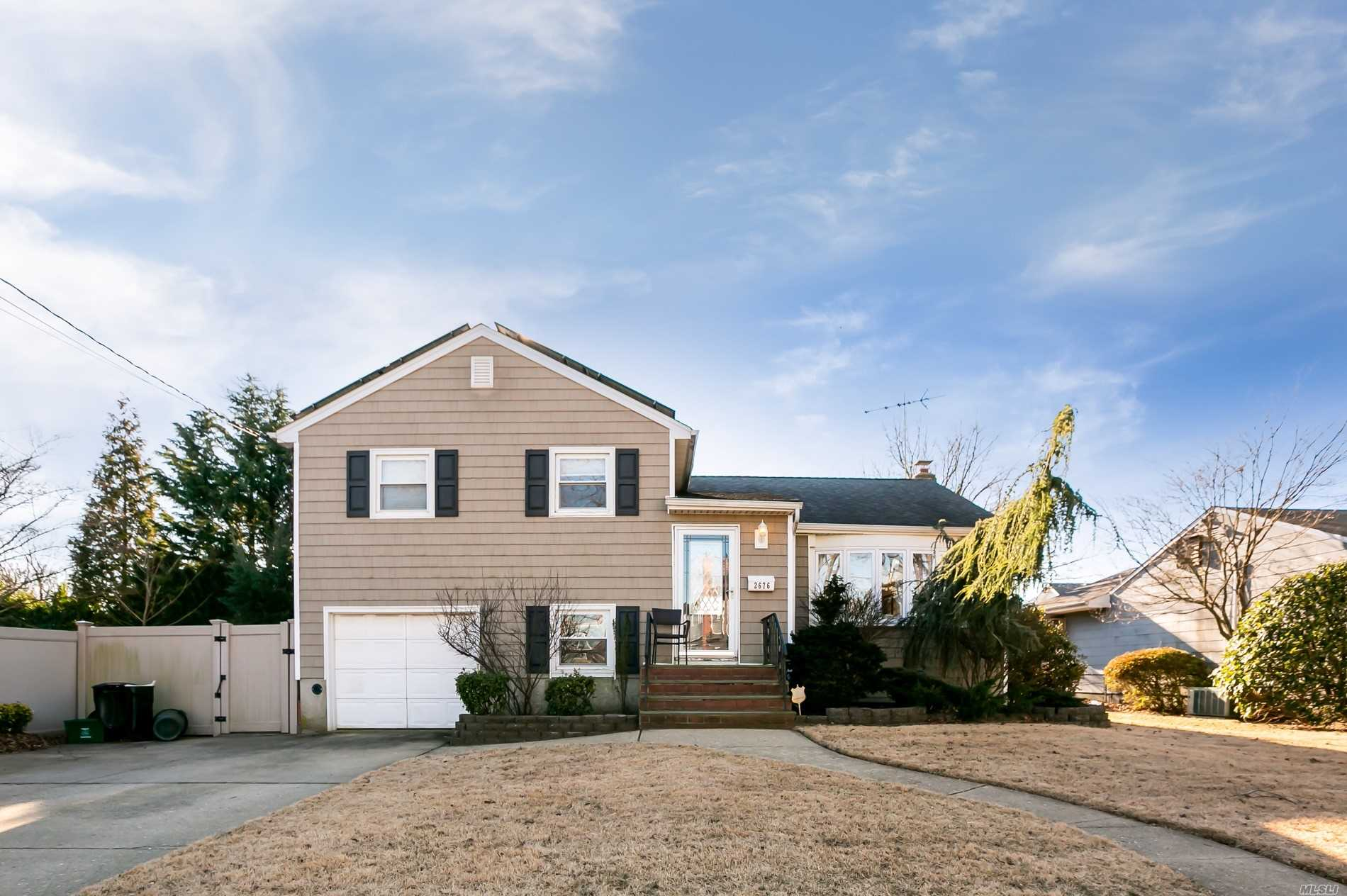 Fabulous Split Level Home On Dead End Street. Living Room, Dining Room, Eat In Kitchen, 3 Bedrooms, 2 New Bathrooms, Den With Ent To Garage, Basement With Outside Ent, Large Yard, Solar Panels, Cac, Gas, Hardwood Flrs, In Ground Sprinklers.