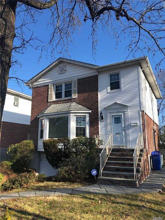 Beautiful Bayside/Weeks Woodland Brick Colonial For Sale Features 3 Bedrooms, 2.5 Baths, Large Eik, Living Room, Dining Room And Full Finished Basement W/Laundry Room. Cac And Hardwood Flooring Throughout. 1 Car Garage W/Driveway + Backyard. View Of Little Neck Bay. In School District 26 And Close To All. Won't Last! A Must See!
