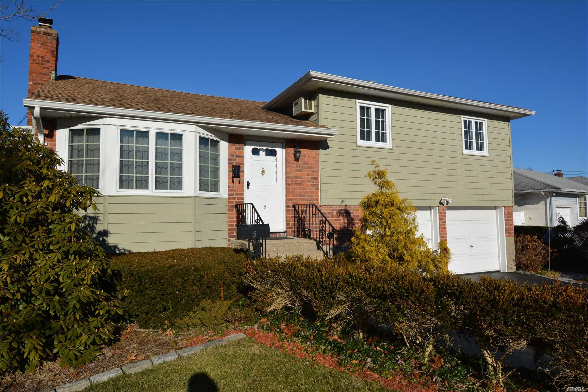 Lovely Maintained W/Updated Arch Roof. Thermopane Windows, Vinyl Siding, Burham Hot Water Heat W/Riello Head, 275 Gallon Oil Tank In Bsmnt. 200 Amp Electric. Oak Floors, Paver Patio. Landscaped Property W/Lots Of Privacy. 2 Car Attached Garage. New Washer/Dryer. Pride Of Ownership.