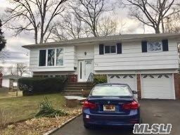 Beautifully Updated Hi-Ranch 4Brs/2Bath, Desirable Syosset School Dist. Close To Shopping, Restaurants, High Way,  Great Location. Large Eat-In-Kitchen, Family Room, 2 Car Garage W/Auto Opener. Immediate Occupancy, Garden Care Included. A Must See!!