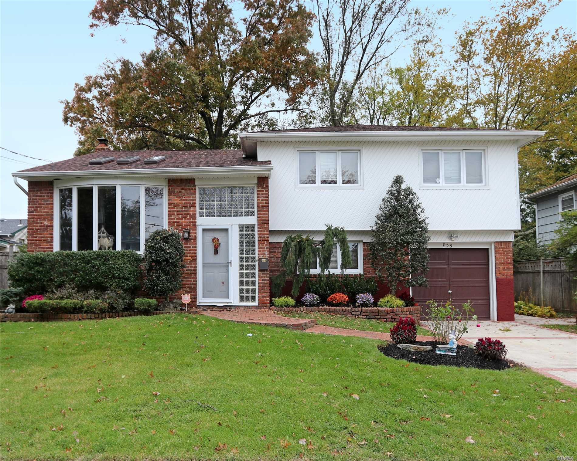 Welcome Home To This Well Maintained Split Located On A Dead End St In Baldwin Harbor! This Home Offers 3 Br's, 2.5 Baths, Flr W/Vaulted Ceilings, Fdr Plus An Eik. The Lower Level Boasts A Den, Office, 1/2 Bath, Access To The Yard & Entrance To The 1 Car Attached Garage. The Part Bsmt Includes A Separate Laundry Room, Utility Room And Add'l Storage. The O/S 133' Deep Property Is Fully Fenced & Accessible From The Eik. Don't Miss The Opportunity To Make This House Your New Home!