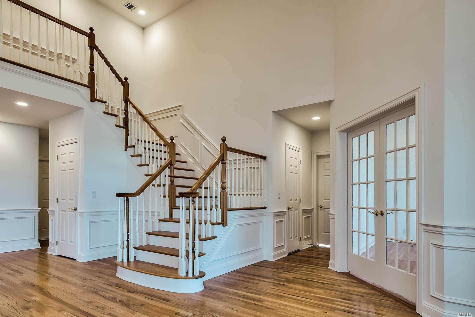 This Luxurious Sun-Drenched Ashford Model Is In A Prime Location, Backing The Pond On A Cul-De-Sac. The 1st Floor Features An Elegant 2-Story Entry With A Grand Staircase And Is Home To A Large Open Concept Living/Dining Room, Family Room With Fireplace, Master Suite, Office/Bed, A Guest Suite, Eik And Laundry Room. The Kitchen Boasts Beautiful Bay Windows That Overlook The Backyard And Pond With Direct Access To A Wooden Deck. The 2nd Floor Offers An Additional Guest Suite.
