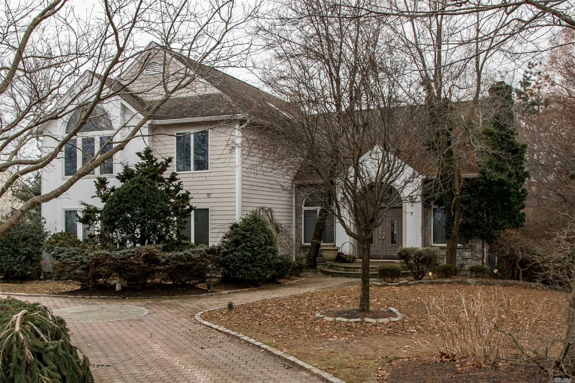 Spectacular Post Modern W/Views Of Li Sound In A Private Beach Community. Features 4/5 Large Bdrs, 4.5 Baths, Hwd, Ceramic, Hi-Hats, Fieldstone Frpl, Cvac, Full Above Ground Walk-Out Basement W/Rm For Mom, 3-Car Heated Garage, Ig Pool, Slate Porch, Waterfalls, Pond, Igs, Fenced Property, Awning, Alarm, Intercom, & So Much More!