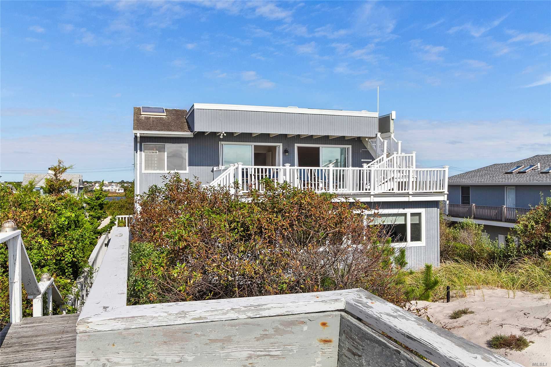 The 360 Degree Ocean And Bay Views Are Not To Be Missed At This Between The Bridges Contemporary Home, Especially From The Rooftop Deck. This 2300 Sq Ft Oceanfront Home Offers 75 Feet Of Sandy Beach With 5 Bedrooms And 4 Baths. Open Floor Plan On The Main Floor With Living/Dining Area, Fireplace, Kitchen, Large Den, 3 Bedrooms, Laundry. The Upper Floor Has A Master Suite, Sitting Room And Deck. Heated 20X40 Gunite Pool, Hot Tub And Cabana With Full Bath.