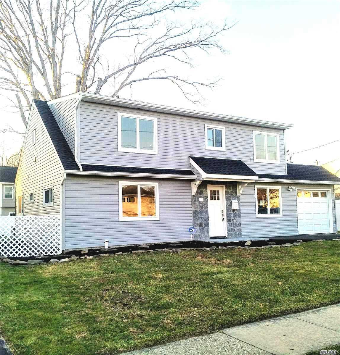 Newly Dormered And Fully Renovated 4 Bedroom, 2 Full Bath Colonial In Much Desired Massap Sd #23. New Boiler, Hi Eff Gas Heating & Cac, 1 Car Garage, Huge Eik, Fdr, 2 Poss Mbr's, Ovrszd Backyard, 220 Amp Elec, & Many Green Features...Adjacent To Beautiful Park , Only 1/2 Mile From Lirr. Only 6 Blocks South Of Sunrise Hwy, And North Of Merrick Rd.. Ready To Be Home Before Spring?! Hurry!!