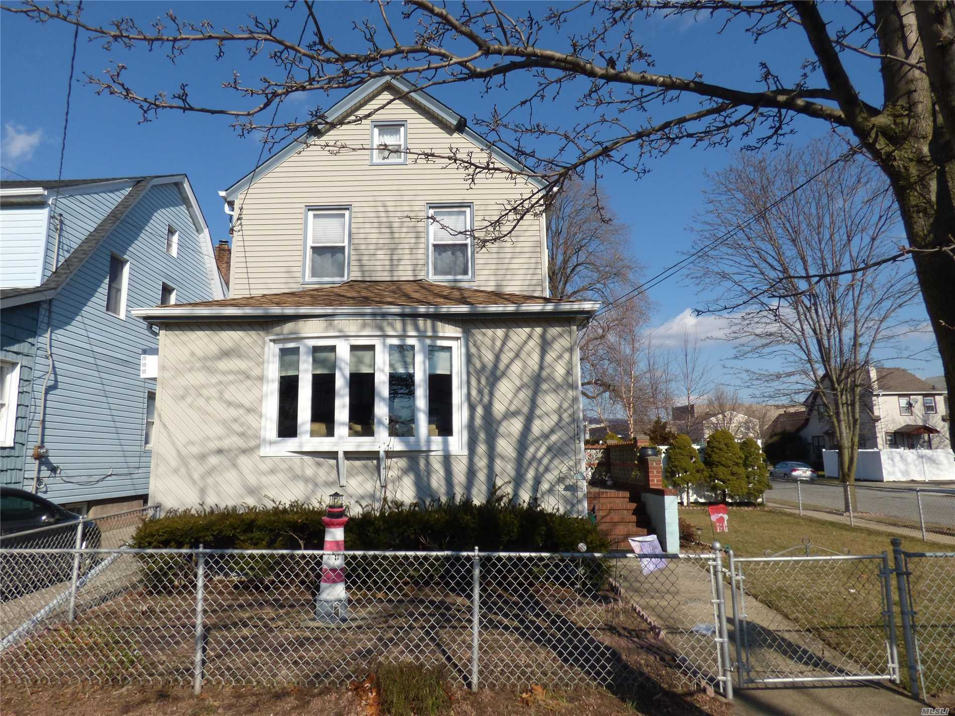 Charming Well Maintained 3 Bedroom, 1 Bath Colonial On A Corner Lot With 2 Car Garage. Oversized Living Room Opens To Formal Dining Room, And Eat In Kitchen. 2nd Floor Features 3 Bedrooms, And Updated Marble Bath With Walk In Shower; Basement Playroom, With Plenty Of Storage And Ose. Vinyl Fenced Backyard Has Hot Tub For Those Achy Joints. New Gas Boiler, New Naview Tankless Hw. Walk To Lirr And Bus, Close To All. Too Much To List .Must See!!