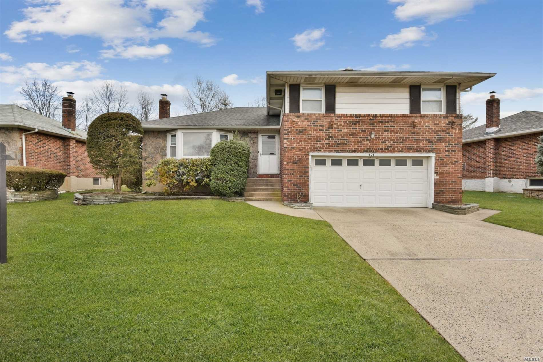 Must See This Lovely, Brick Split In Prime Salisbury Estates, Featuring 3 Spacious Bedrooms, 2.5 Baths, Large Living Room, Formal Dining Room, Great Eat-In-Kitchen, Whole House Has Been Freshly Painted, Hardwood Floors throughout, great Den With New Floors And Sliders To A Private Backyard, 2-Car Attached Garage. Low Taxes!!