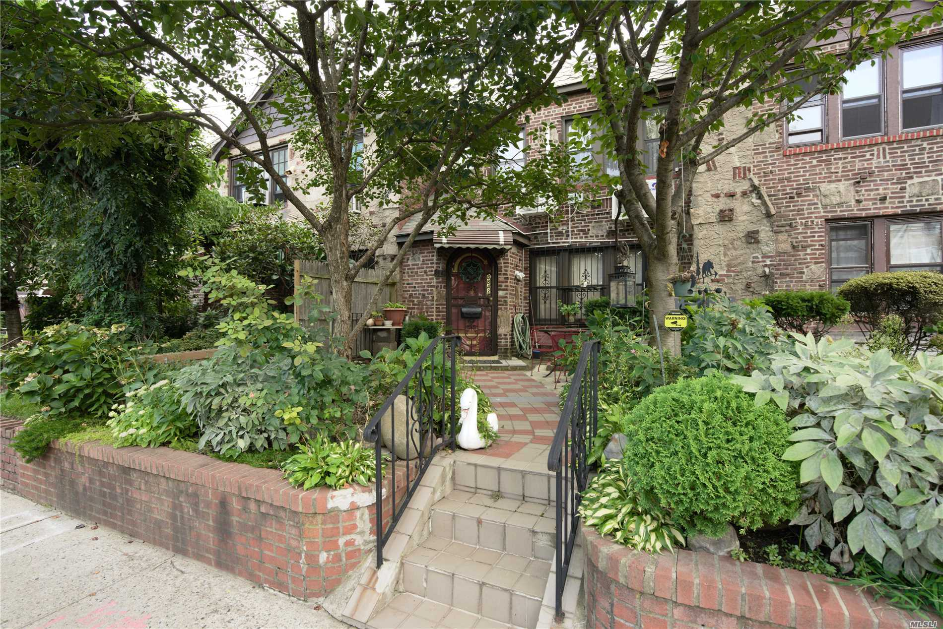 Beautiful Brick Tudor Townhouse. Excellent Condition With Updated Kitchen And Bathrooms. Hardwood Floor Throughout. Ductless Split A/C. Finished Basement. 4 Bedrooms, 2 Full Baths, Det. Garage. Very Good School District. Minutes Away From The R, M Train Station And Shopping Centers. Must See!!!