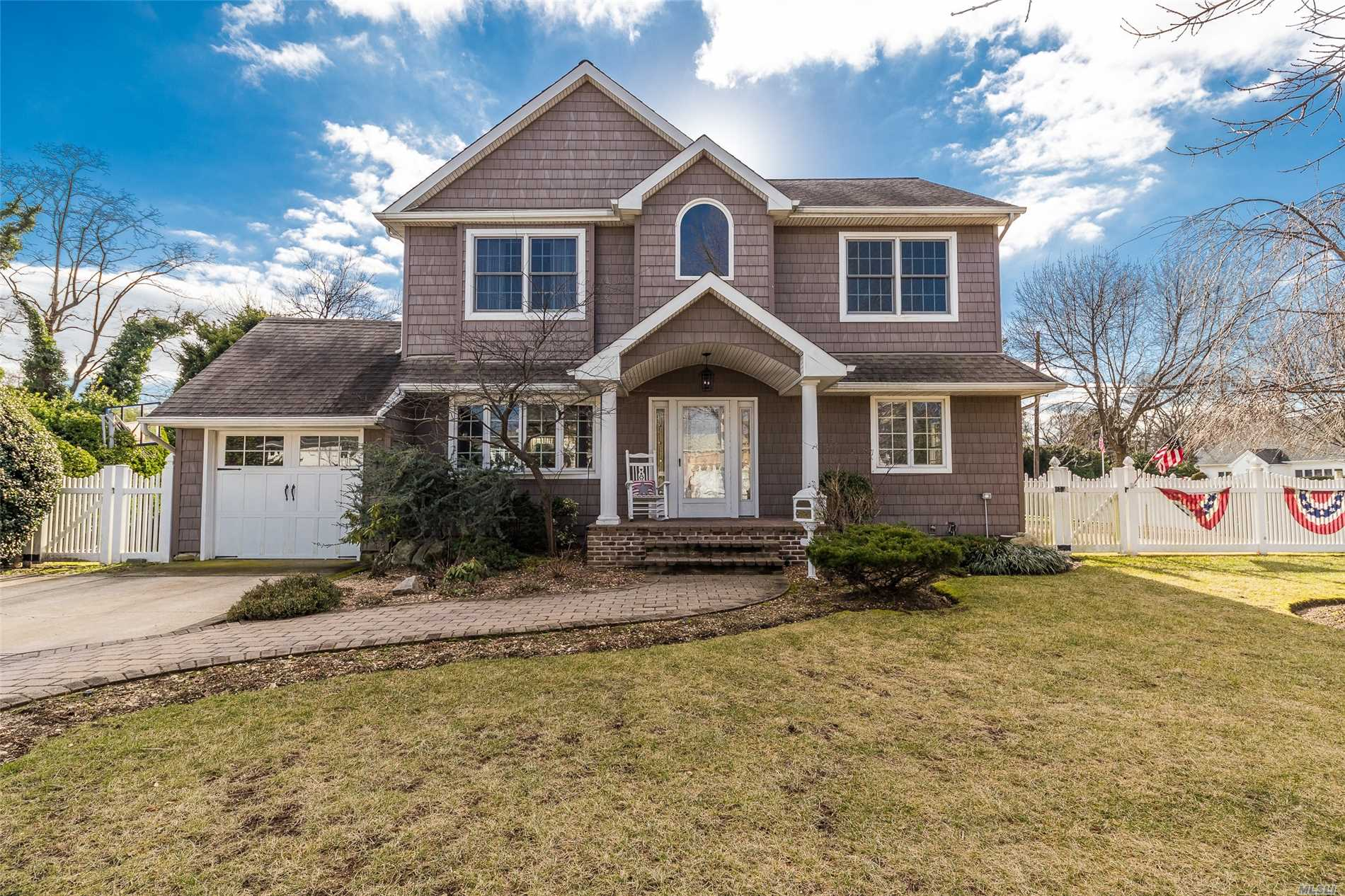 Spacious Center Hall Colonial On 100X100 Corner Lot In Massapequa Sd. Grand Entry Foyer With Soaring Tray Ceilings, Fireplace, Multiple Family Rooms, Eat In Kitchen, And An Abundance Of Natural Light Year Round! 1 Br Downstairs, 4 Br's Up, Serene Backyard With Endless Possibilities.