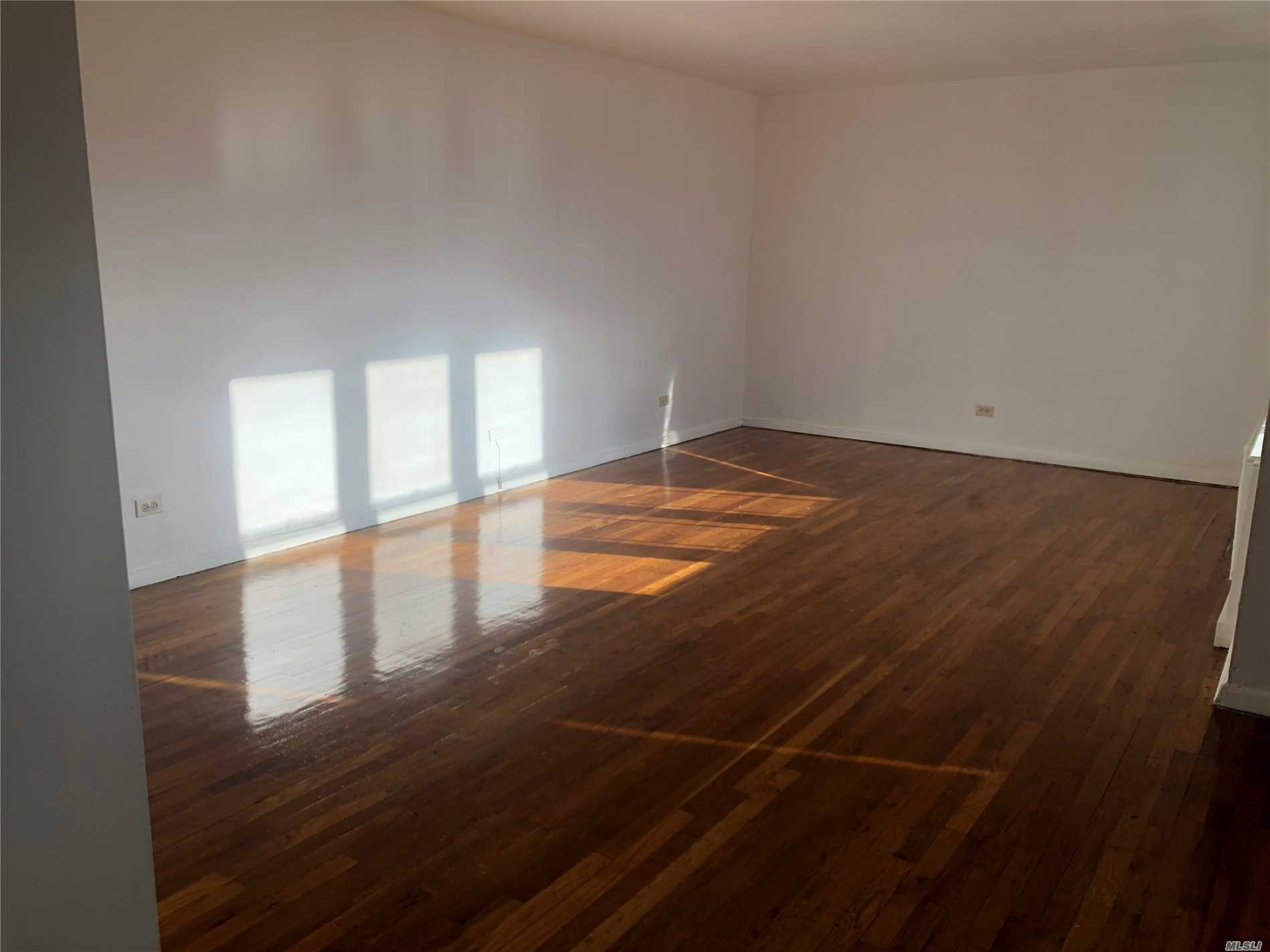 New Fresh Paint And Hardwood Floor, Sunny Bright 1200Sqft, Minutes To #7 Subway Main St Station And Lirr, One Block Away From Supermarket, Convenient To All.