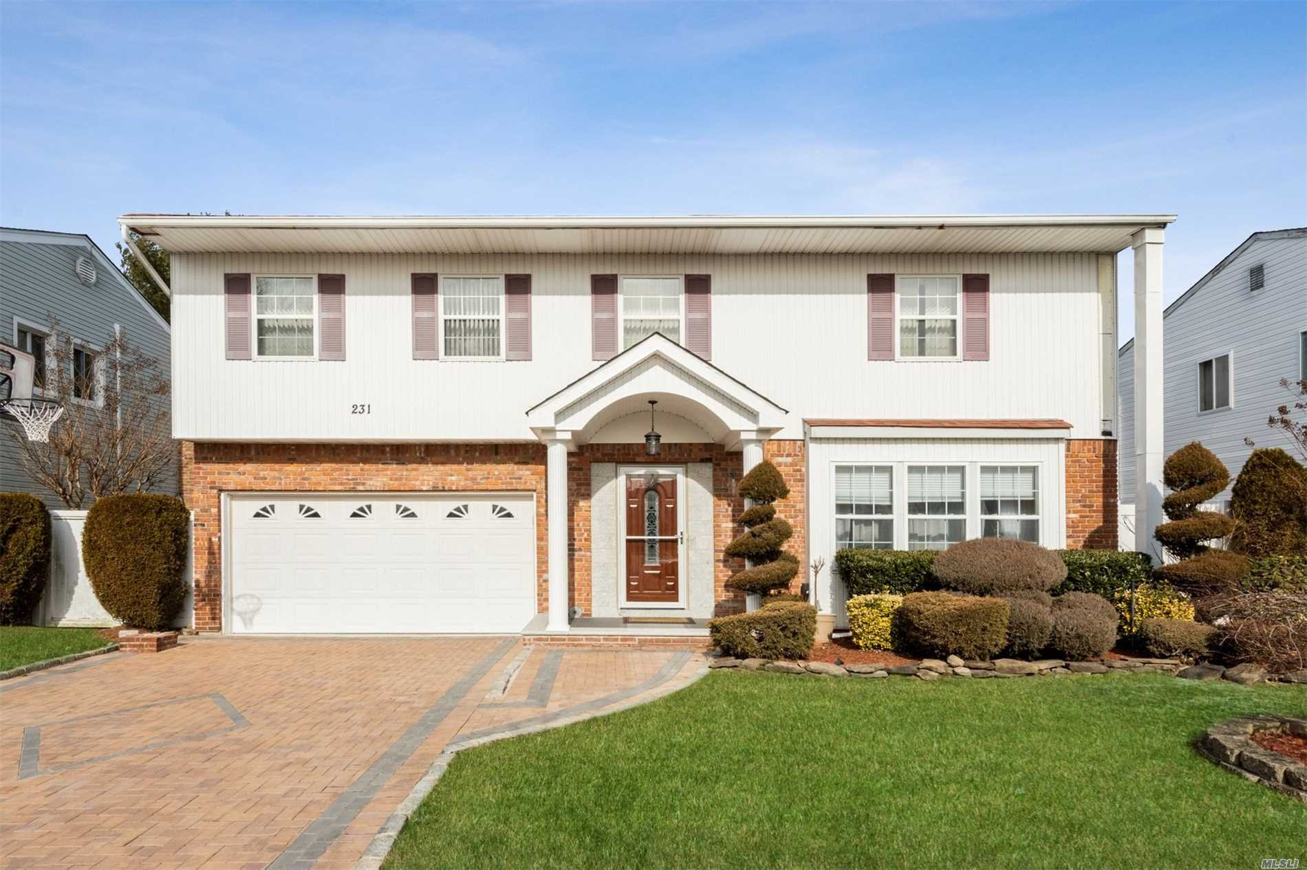 Spacious & Gracious, Diamond Colonial, Huge Eik, 4/5 Bdr. Tall Basement, Impressive Master Bedroom With Walk-In Closet. 2 Skylights (1st Floor & 2nd Floor), Recently Updated Granite Counter In Kitchen. Deck In Backyard Has Awning. Roof Is 2 Yrs Old. New Driveway.