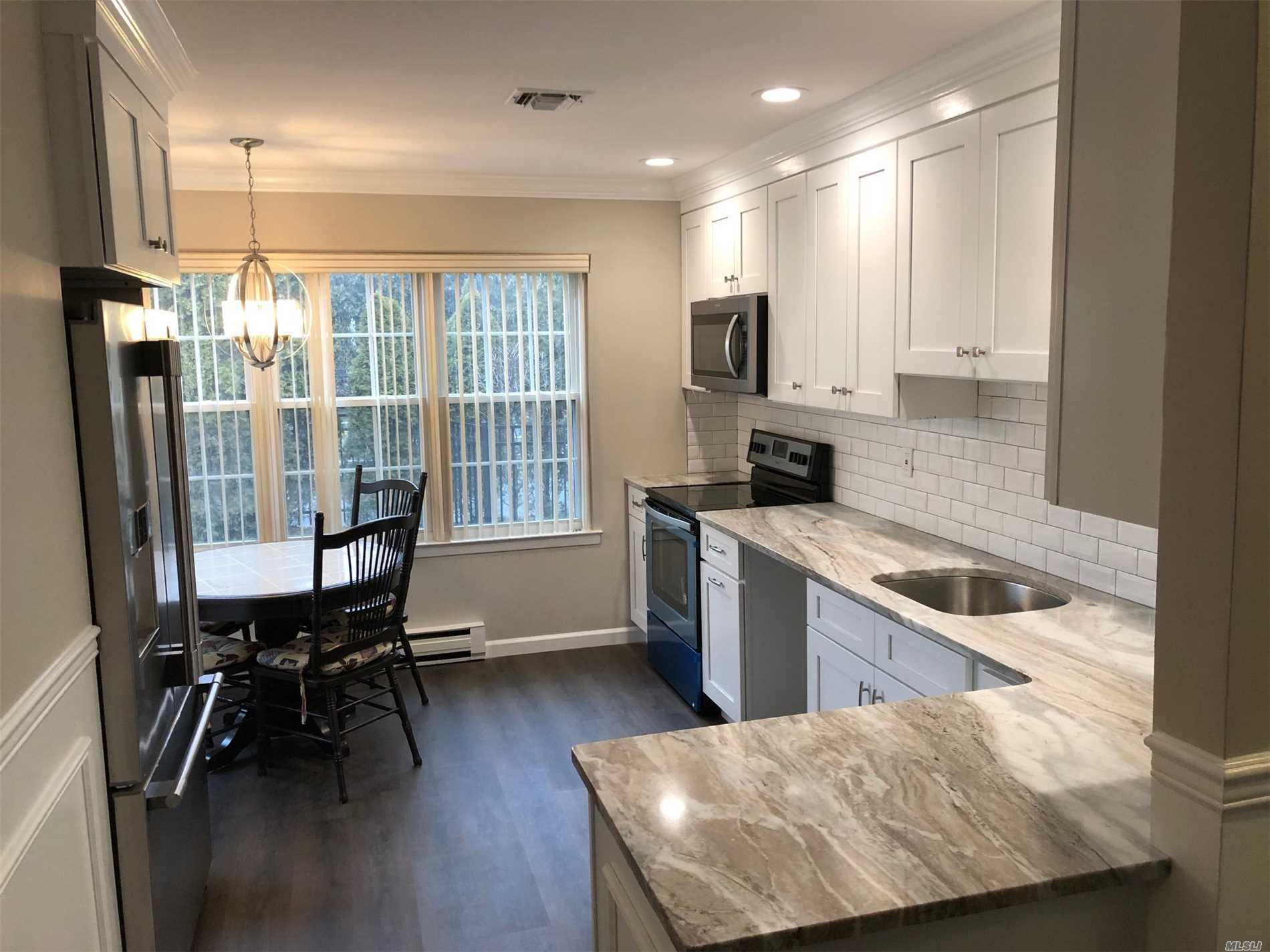 Totally Renovated. Better Than New! Granite, With Ss Appliances,  Counter-Depth French Door Frig, Custom Molding, Marble Tile Floors, Custom Molding Throughout, All New Flooring. High End Hamptons Builder. Nicer Than Photos! Largest Dartmouth Model!