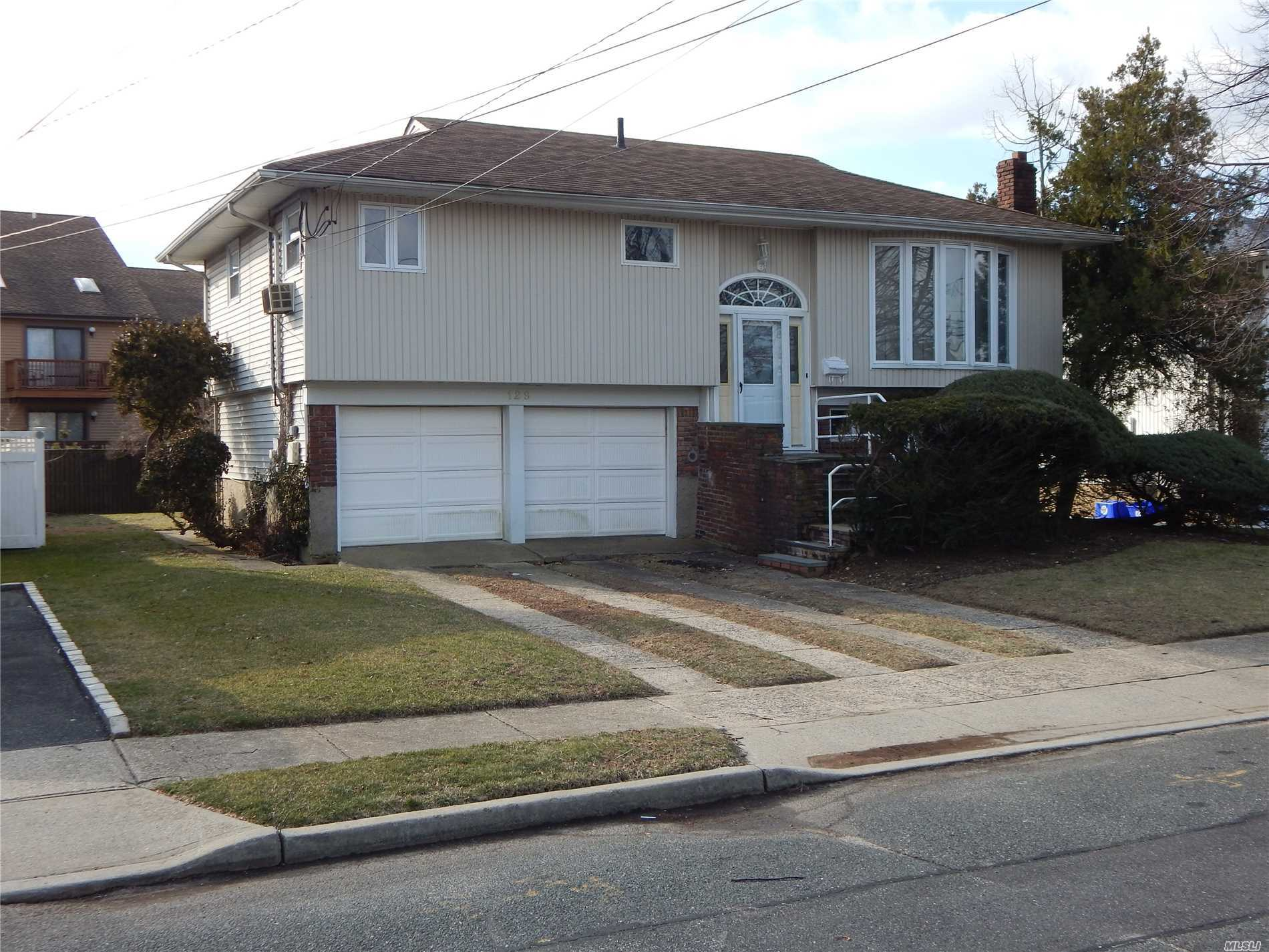 Ocean Lea Section Hardwood Floors Throughout Mostly Updated Windows, Siding, Bathrooms And Oil Heating System With Above Ground Tank. Open Floor Plan Up With Generous Living Room, Formal Dinning Area, Eat In Kitchen With Ose To Rear Deck And Patio.Yard. Main Level Den With Sliders To Patio And Yard Plus Full Bath With Additional Laundry Room And Storage Area.