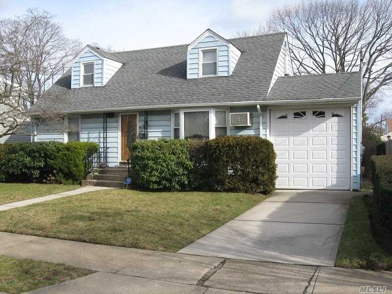 Rear Dormered Cape With 3 Full Baths, Oversized Garage, Very Large Property, Plainedge Public Schools, Near Expressway & Parkways, Easy Access.