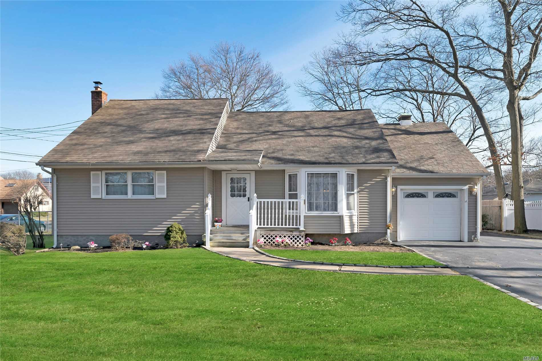 Very Well Maintained Spacious Home On A Large Corner Lot. Large Backyard With Room For Pool / Entertaining. Roof, Siding, Windows And Burner All Replaced Within 10-15 Years. Hardwood Floors, Beam And Plank Ceiling In Dining Room, Full Unfinished Basement. Priced To Sell. Move In Ready.