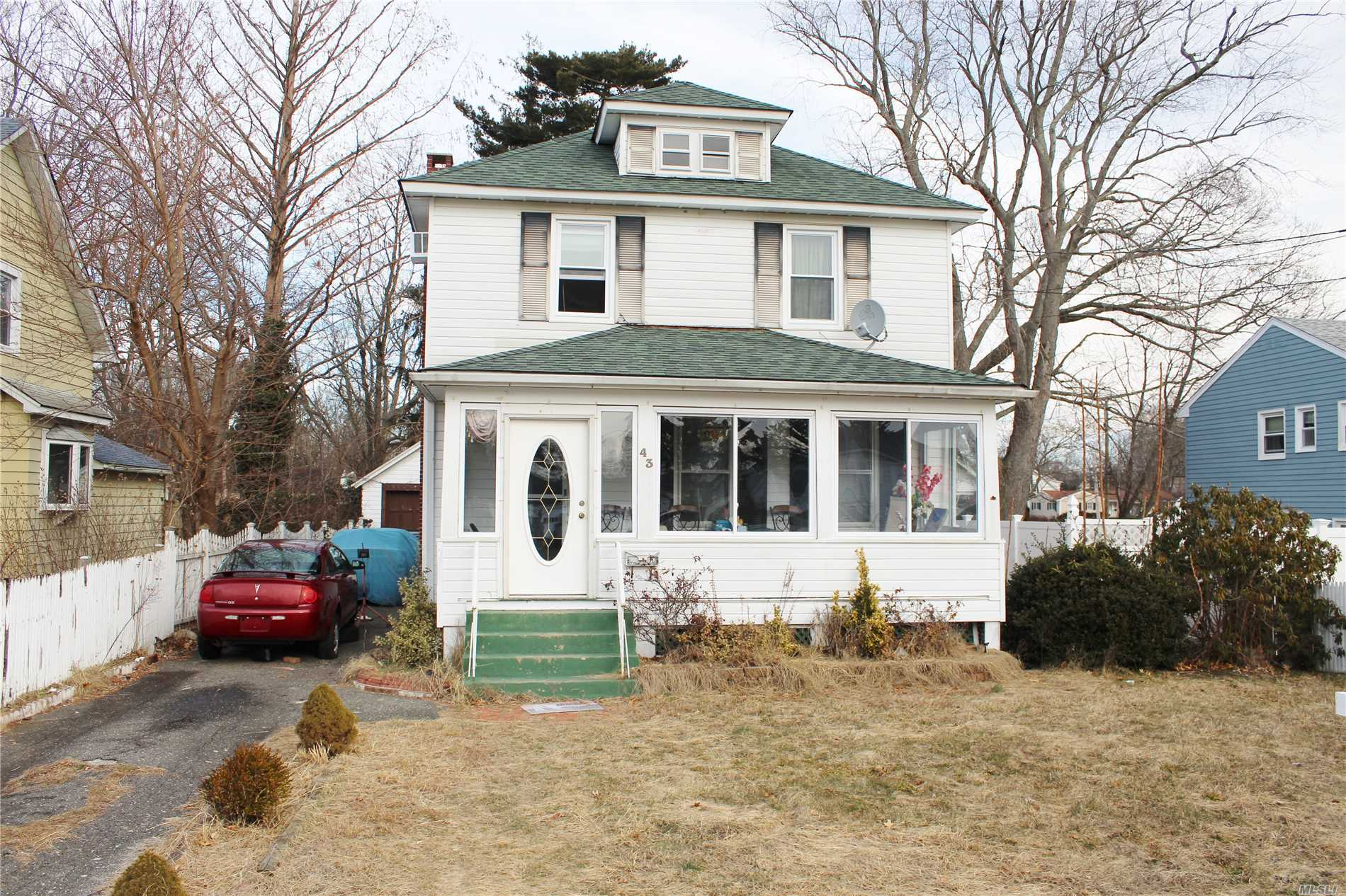 Located Outside Patchogue Village But A Short Distance Into Town This Fantastic 4 Bedroom 2.5 Bath Colonial Home Has Low Taxes But Plenty Of Space. Many Updates In The Past 5 Years Including Roof, Windows, Tile Work In The Bathrooms, New Gas Heat And Hot Water, Porch Enclosure And More. This House Has Charm And Character Which You Can Add Some Finishes Too Turn It Into Your Own Personal Paradise