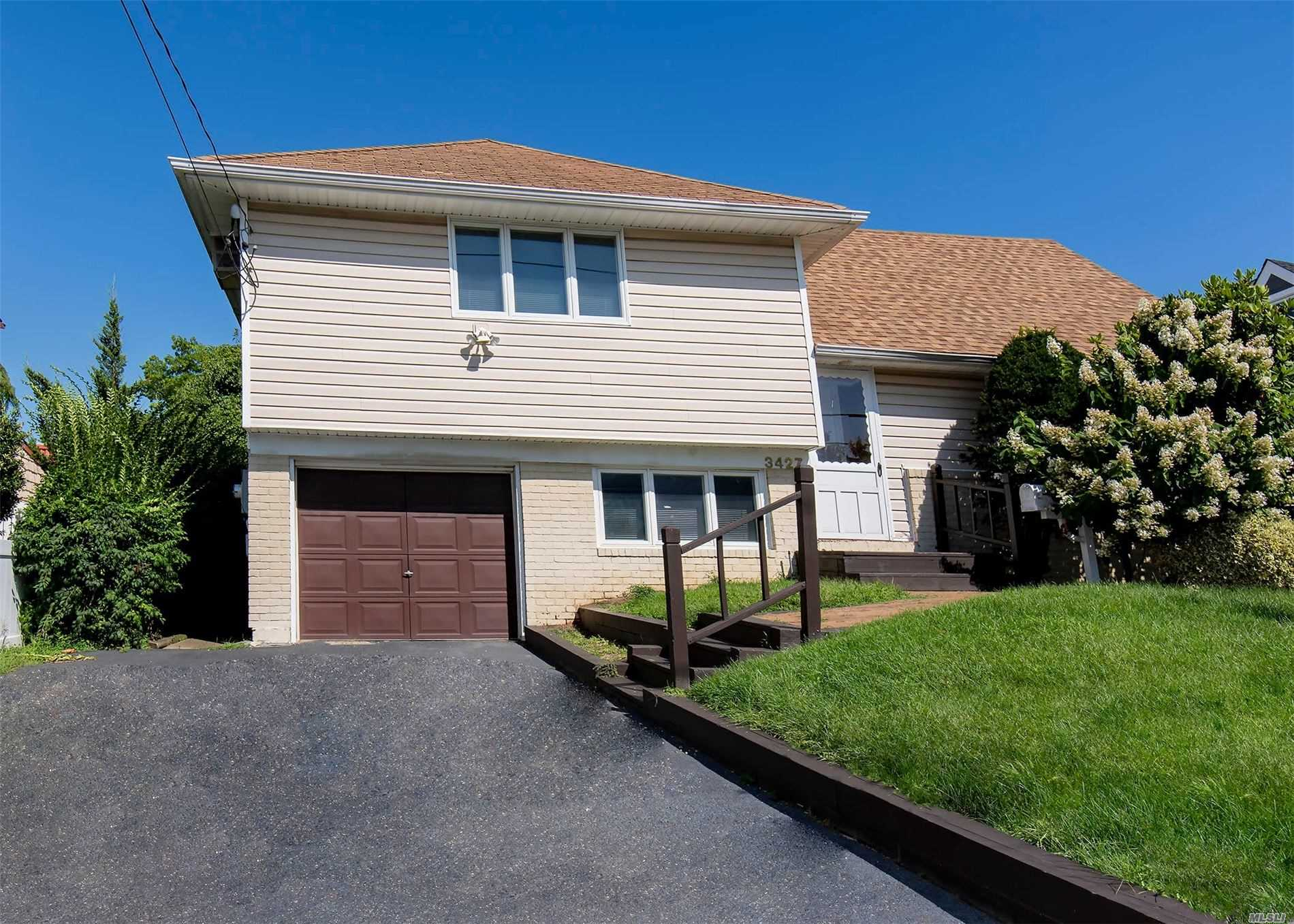Oceanlea Split 3 Bedrooms, 2 Full Baths, Lower Level Office, Added On Den W/Sliding Door To Deck. Expanded Eik, Formal Dining Room, Living Room. Inground Sprinklers, New Oil Tank. Close To Shopping. Public Transportation. Close To House Of Worship