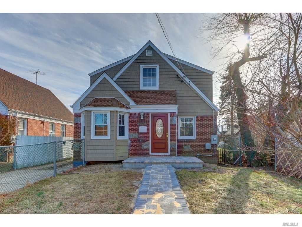 Fully Renovated Large Double Dormered 5 Br 3 Bath Expanded Cape.