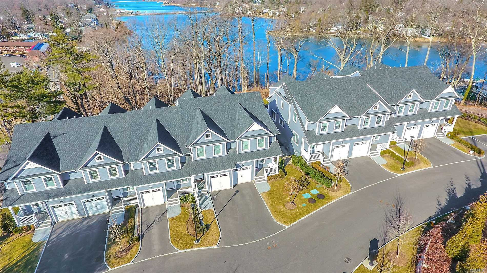 Enjoy Spectacular Water Views & See The Eagles Soar Over Centerport Harbor! Open Concept Floor Plan. Great Room With Coffered Ceiling , Custom Mill Work & Hardwood Flooring Throughout. 9' Ceilings On First Floor. Beautiful Kitchen& Baths- Deluxe Energy Efficient Stainless Steel Appliances & Custom Quartz Counter Tops & Jacuzzi Tub & Separate Shower In Mbth. Private 1.5 Acre Common Area. Special Financing Available. Luxurious, Chic & Sophisticated Living At It's Best!