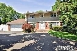 Large Home With Fantastic Over-Sized Property. Featuring Spacious Rooms, Family Room With Fireplace, Deck Off Kitchen. Minutes To Railroad, Town, Golf Course, And Park. Near Northern State Pkwy And 495 Highway, Convenient To All.