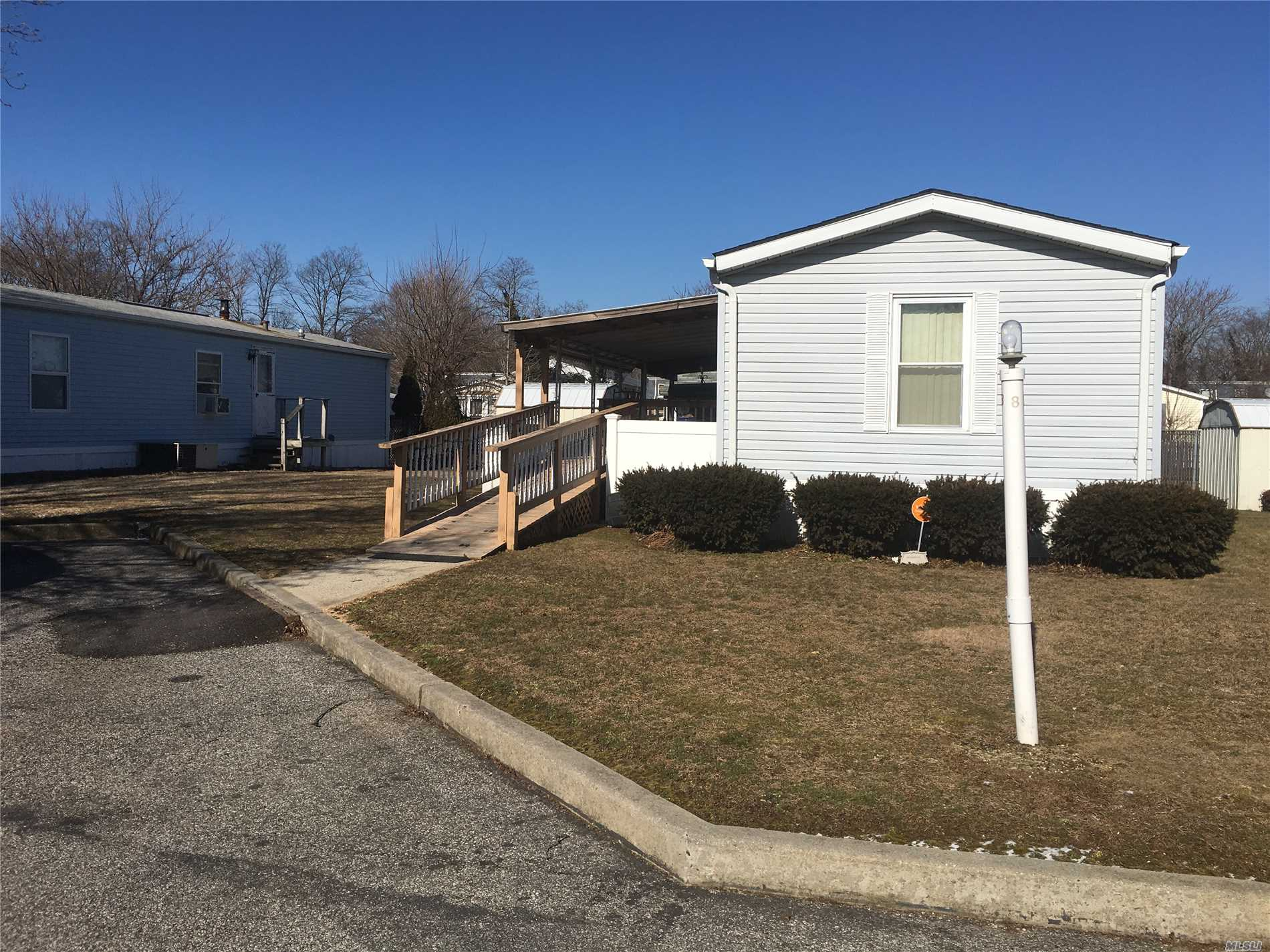 Quiet Location Convenient To All. Fenced Property- Nice Covered Patio With Yard - Fenced Area For Dog - 2 Sheds Affordable Living. Great Neighbors.  Common Expense Monthly $850.00 W/Star $797.00 Includes: Land Rental, Taxes, Water, Garbage & Sewer