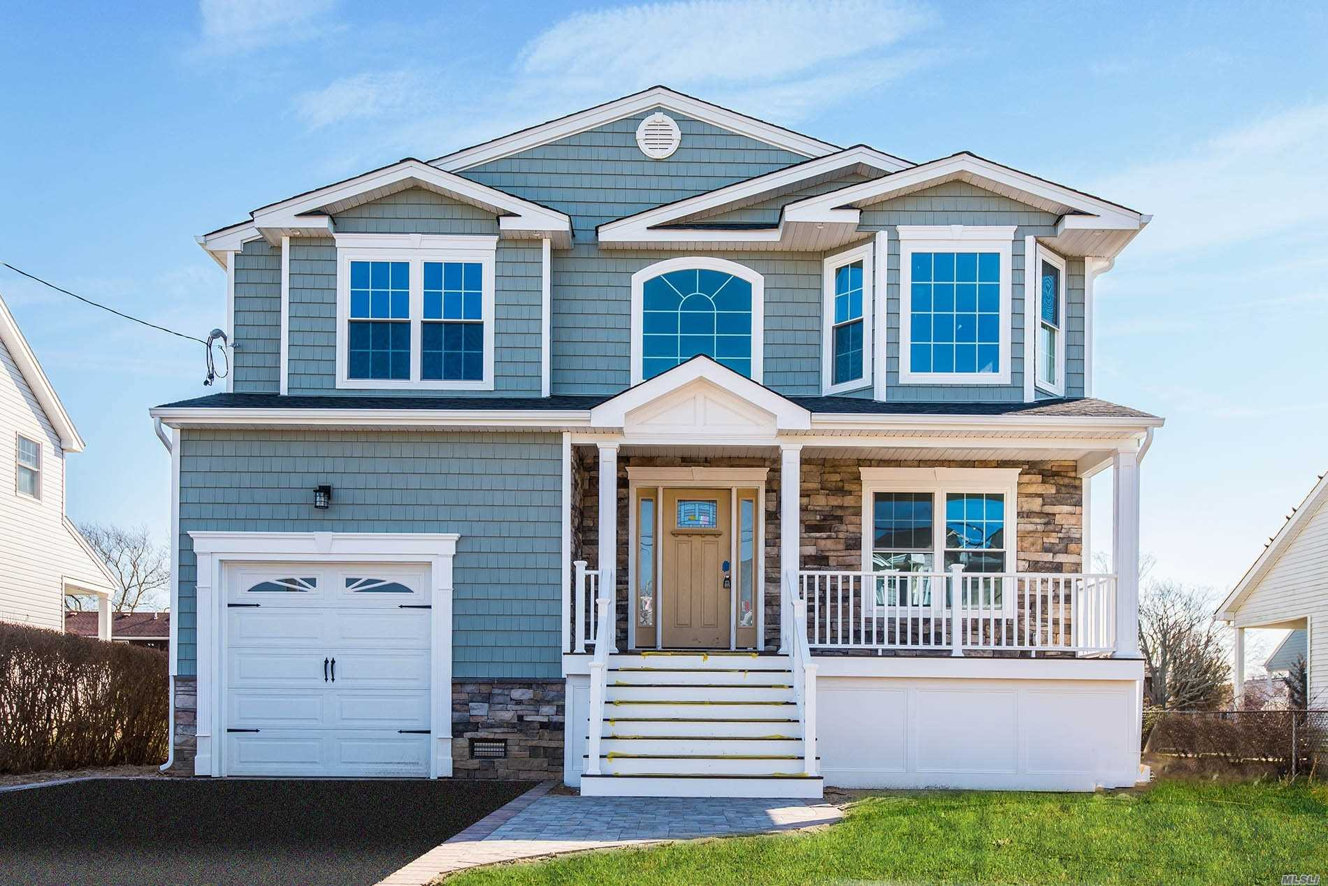 Stunning New Construction Waterfront Colonial Seconds To The Bay. Large Open Concept. Custom Designed Eik W/7Ft Granite Island , Pantry, Sliders To Backyard, Family Room W/ Gas Fireplace.Formal /D/R & L/R. 1/2 Bath, 2nd Fl Features: Designer M/B/Suite Cathedralized & Skylights, Wic, Sliders To Balcony With Bay Views, 3 Lge Additional B/R, Full Bath, W/D 2nd Fl Custom Crown Molding Through-Out, Cac, Hvac, Igs, Landscape, Pavers.Built High Elevetion To Fema, Move Right Into Your Dream Home