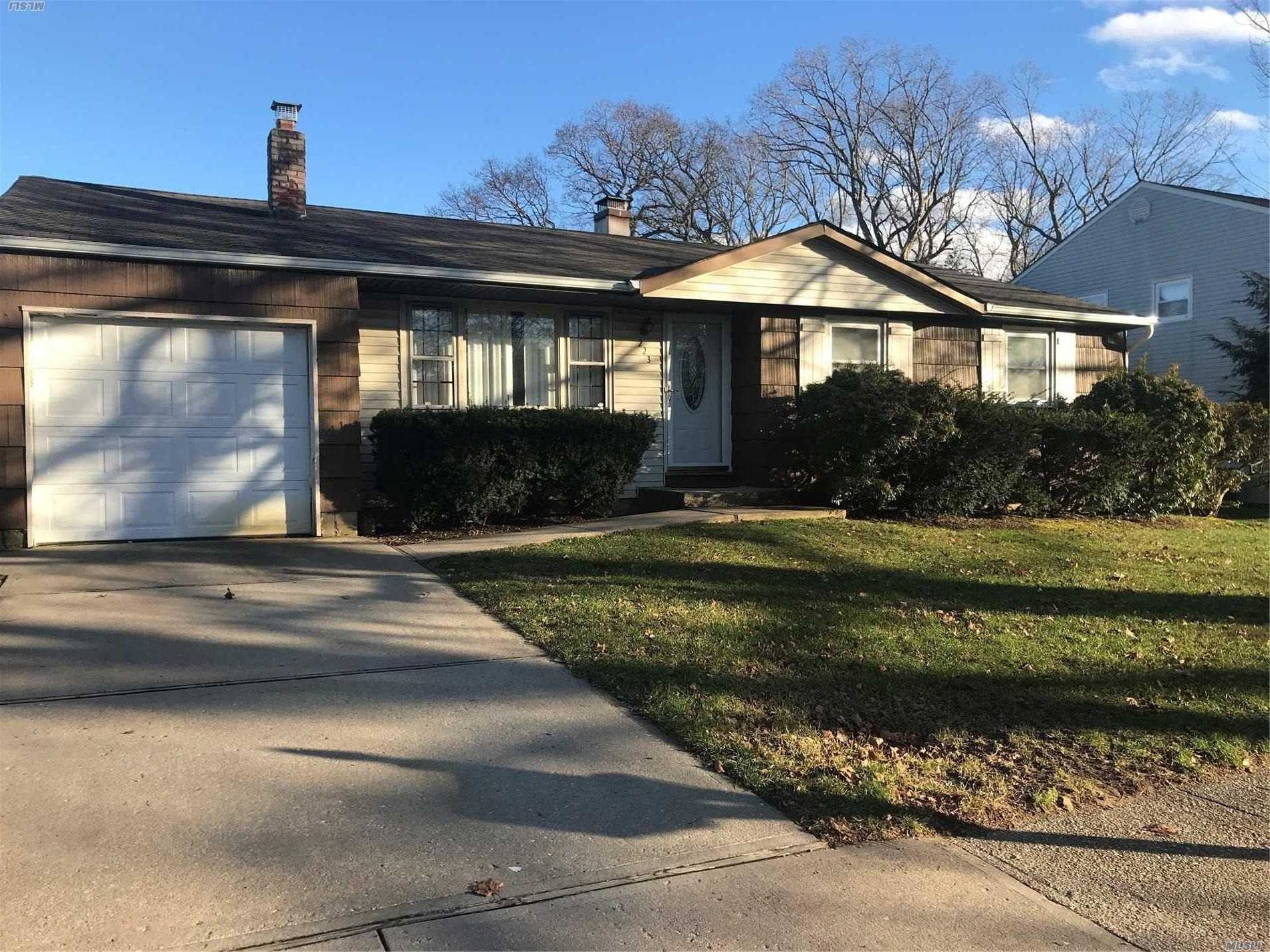 Freshly Painted Ranch With Stainless Steel Appliances, Granite Counter Tops, Open Floor Plan, New Carpet In Den & In Bsmnt, Hardwood Floors Through Out, Carpet In All Bed Rooms. Fire Place Can Be Re Opened, Was Not Being Used. Has security system in place, Fenced In Yard, New Front Larson Oval Glass Door Installed, California Closets In Middle Rm And Master. Elec Front Garage Door, One Car Garage With Attic Entrance, Brand new oil tank, Central Air, Good Roof Hi Hats In Kitchen. Well Maintained