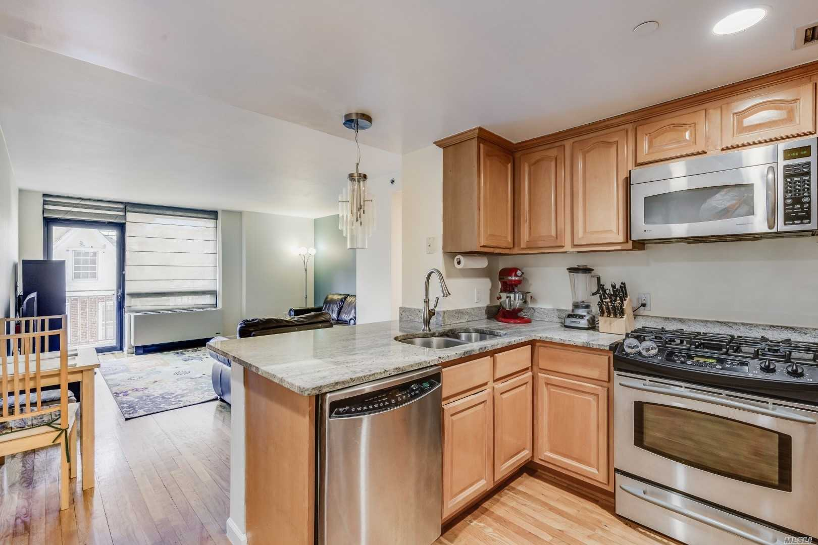 **Motivated Seller**Immaculate 3rd Fl Condo Offers A Private Terrace (126 Sqft) And Balcony With 2 Bedroom , Large full Bath, Granite Kitchen W/Breakfast Bar, Large Lr/Dr Combo, Hardwood Floors Throughout. Building Offers Laundry, Door Man, Gym, Event Room & An Outdoor Rooftop Deck W/Garden Area On 3rd Floor. Steps Away From Dining, Shopping, Entertainment, Buses Q57, Q54, Forest Park & Transportation Lirr And J, Z, M, R, E, F Trains. Commuters Dream!**Currently No Wait For Spot in Public Garage**