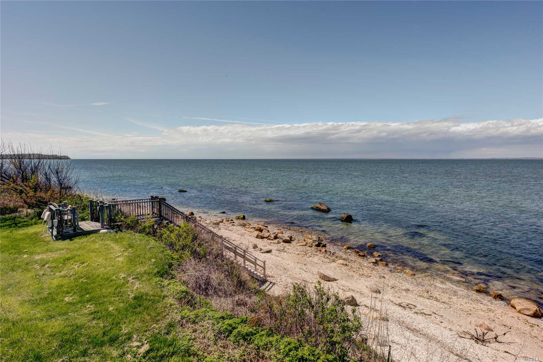 Nantucket-Mint 4 Bedroom, 4 Bath Sound Front Estate On 1 Plus Acres And In-Ground Pool, Lush Waterfront Gardens And A Putting Green. This Home Is Well Appointed With Gorgeous Furnishings, Chefs Kitchen, Large Living Room With Fireplace, Great Room, Den, Sunporch, And Large Seaside Pool With Wonderful Panoramic Views In All Directions. Perfect For Your Summer Vacation.