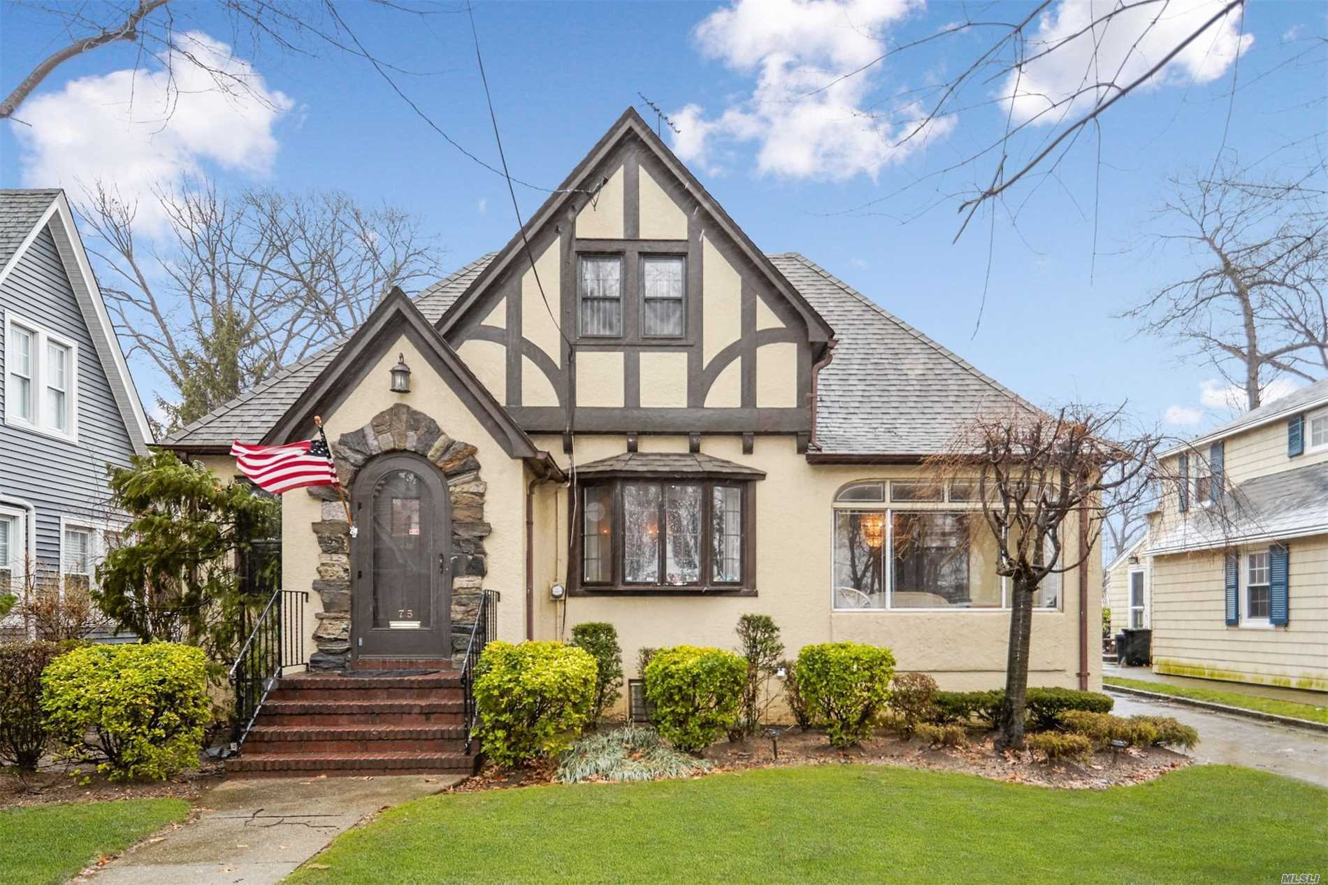 Pristine Tudor/Cape On 50X100 Property In The West End Of The Incorporated Village Of Floral Park.First Floor Has Living Room With Fireplace, Fdr, 2 Bedrooms, Full Bath, Eik, And Enclosed Front Porch. Second Floor Has 1 Bedroom Plus 1 Bonus Room And Attic. Full Finished Basement With Fp. Backyard Has Pavers Patio And Pavers Driveway With 2 Car Garage. Alarm System.