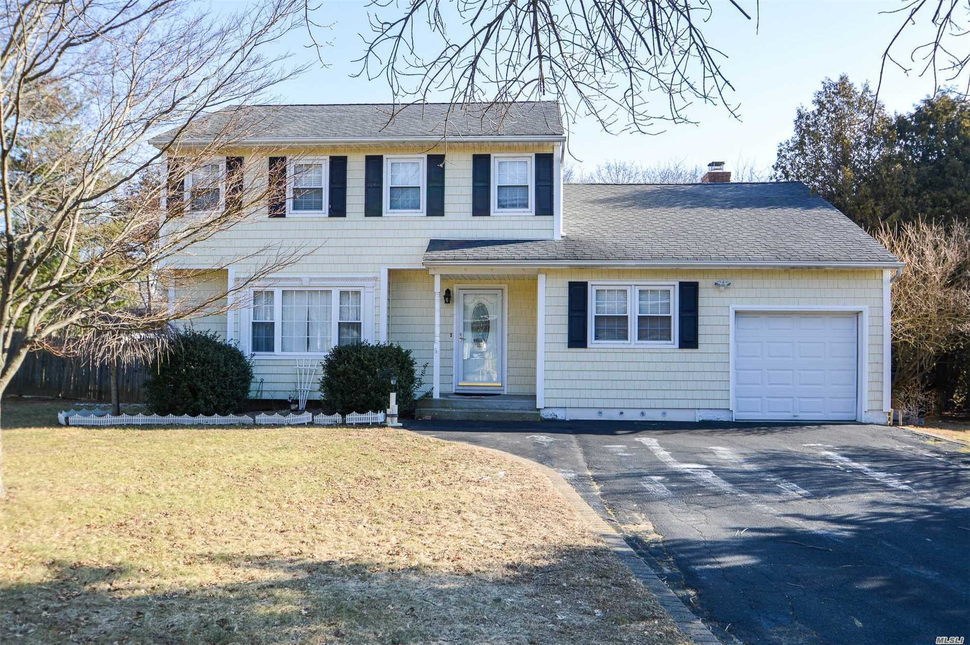 Lovely Center Hall Colonial, bright kitchen with new SS appliances and granite counters. Updated Underground Electrical Service And New Burner. Open Breakfast Nook Looking Out To A Private Fenced In 1/2 Acre Of Property With Great Deck For Entertaining.