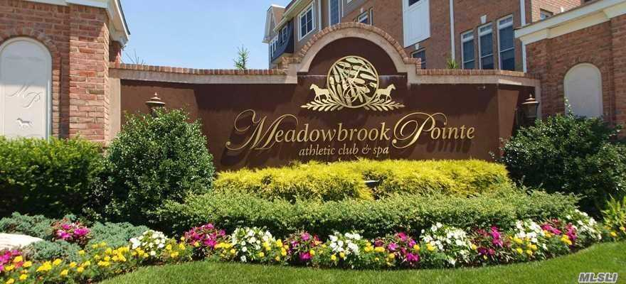 Resort Living On Long Island! Magnificent 1st Floor Unit W/ Water View In The Luxurious Active Adult Community At Meadowbrook Pointe! Light-Filled Corner Unit With Entry Foyer, Hw Floors & Crown Molding Throughout. Freshly Painted With Tray Ceilings, Ss Appliances, Granite Countertops & Walk-In Closets! Amenities Include Clubhouse, 2 Ig Pools, Indoor Pool, Tennis Court, Cafe, Fitness Center, Salon & Spa, Movie Theatre & More! Private Social Director. Tons Of Events! Taxes Being Grieved.