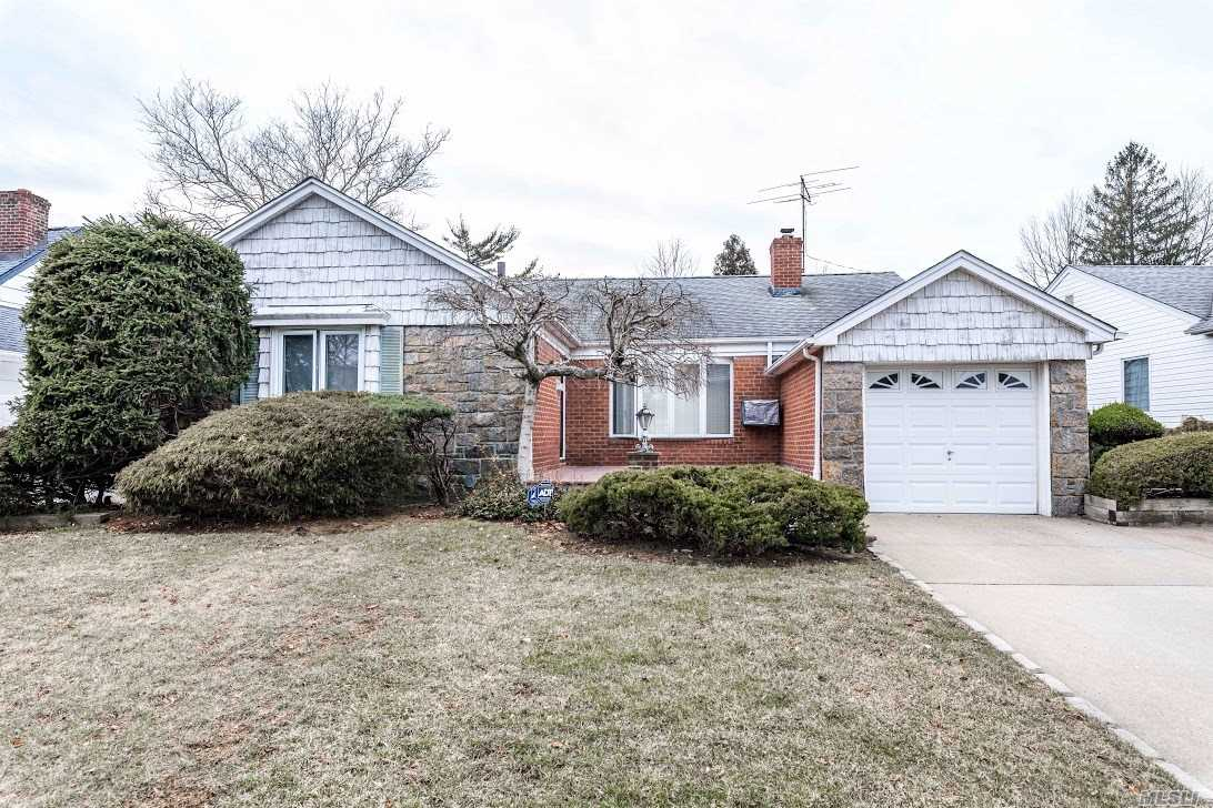 Well Maintained Home In The Heart Of N Valley Stream Being Sold As Is.  Huge Exp Cape Features 2 Bedrooms 1 Bath And Master Bedroom With A Full Bath. Hardwood Floors With Lots Of Storage. Huge Basement 37X16 Entertaining Area With A Bar, Laundry Room And Utility Room. Please Verify All Info